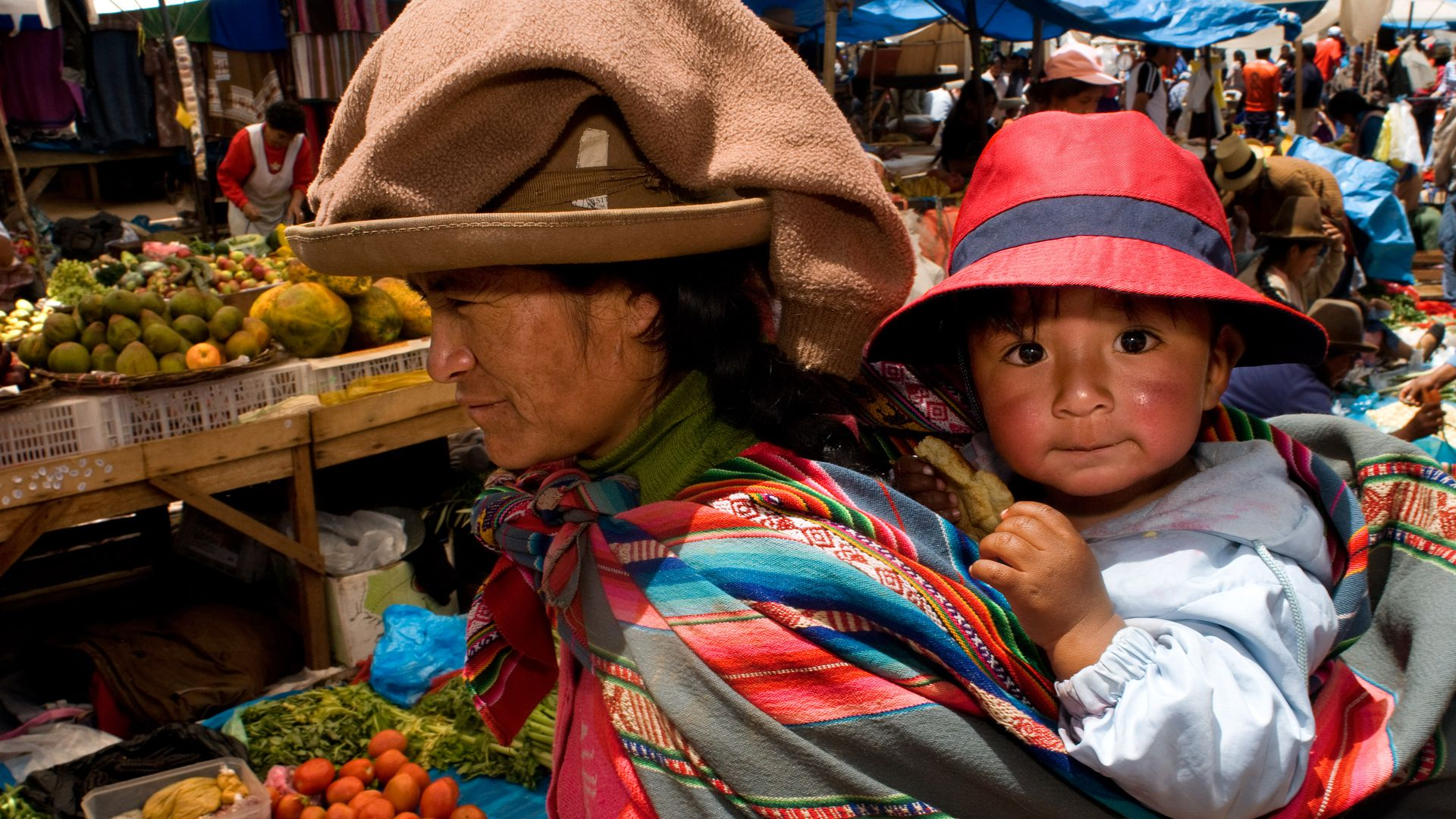 A mother and her son dressed in a traditional costume in Pisac Sunday market day. Pisac. Sacred Valley.