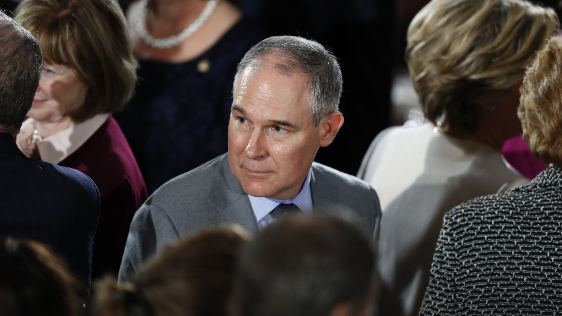 EPA administrator Scott Pruitt looks over his shoulder in a crowd