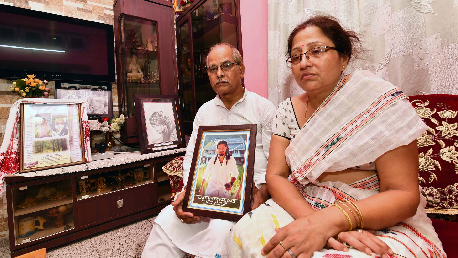 The parents of victim beaten to death by a mob sparked by rumours spread on Facebook and WhatsApp in India about child abductors. Photo credit should read Biju Boro/AFP/Getty Images