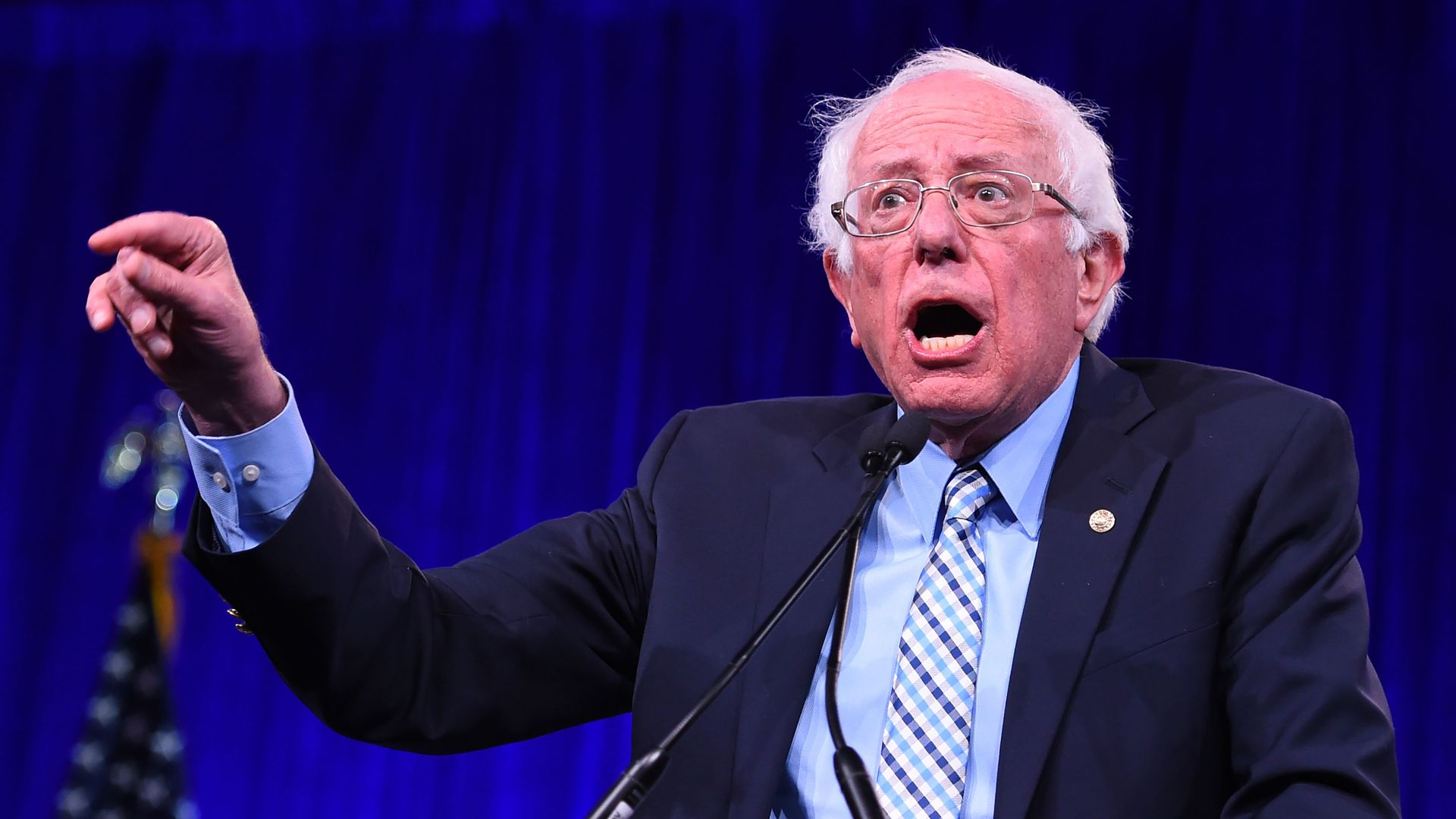 Democratic Presidential hopeful US Senator for Vermont Bernie Sanders speaks on-stage during the Democratic National Committee's summer meeting in San Francisco, California on August 23