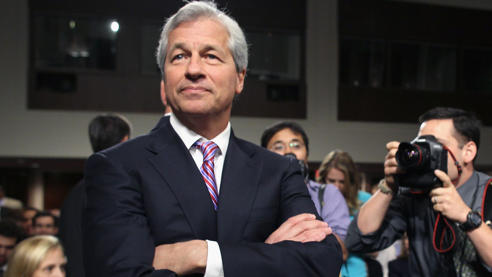 JP Morgan CEO Jamie Dimon poses with his arms folded.