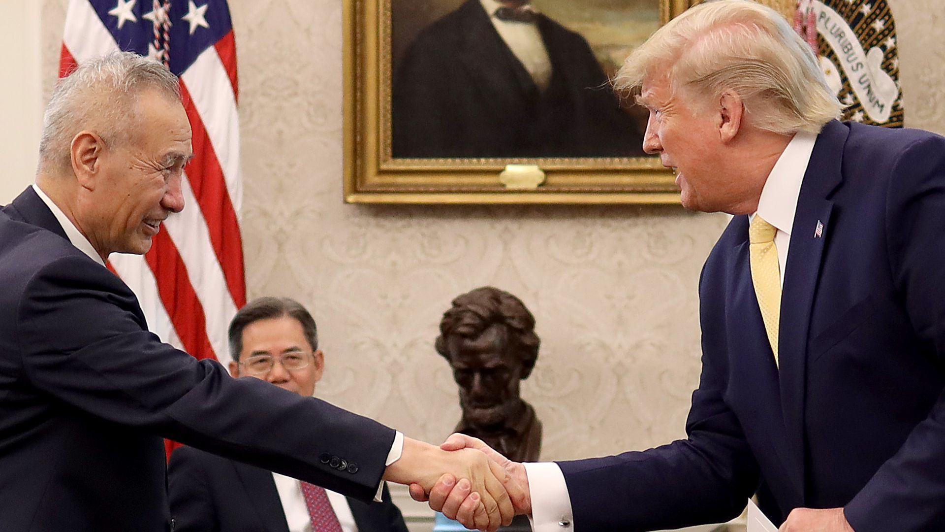 President Trump shakes hands with Chinese Vice Premier Liu He.