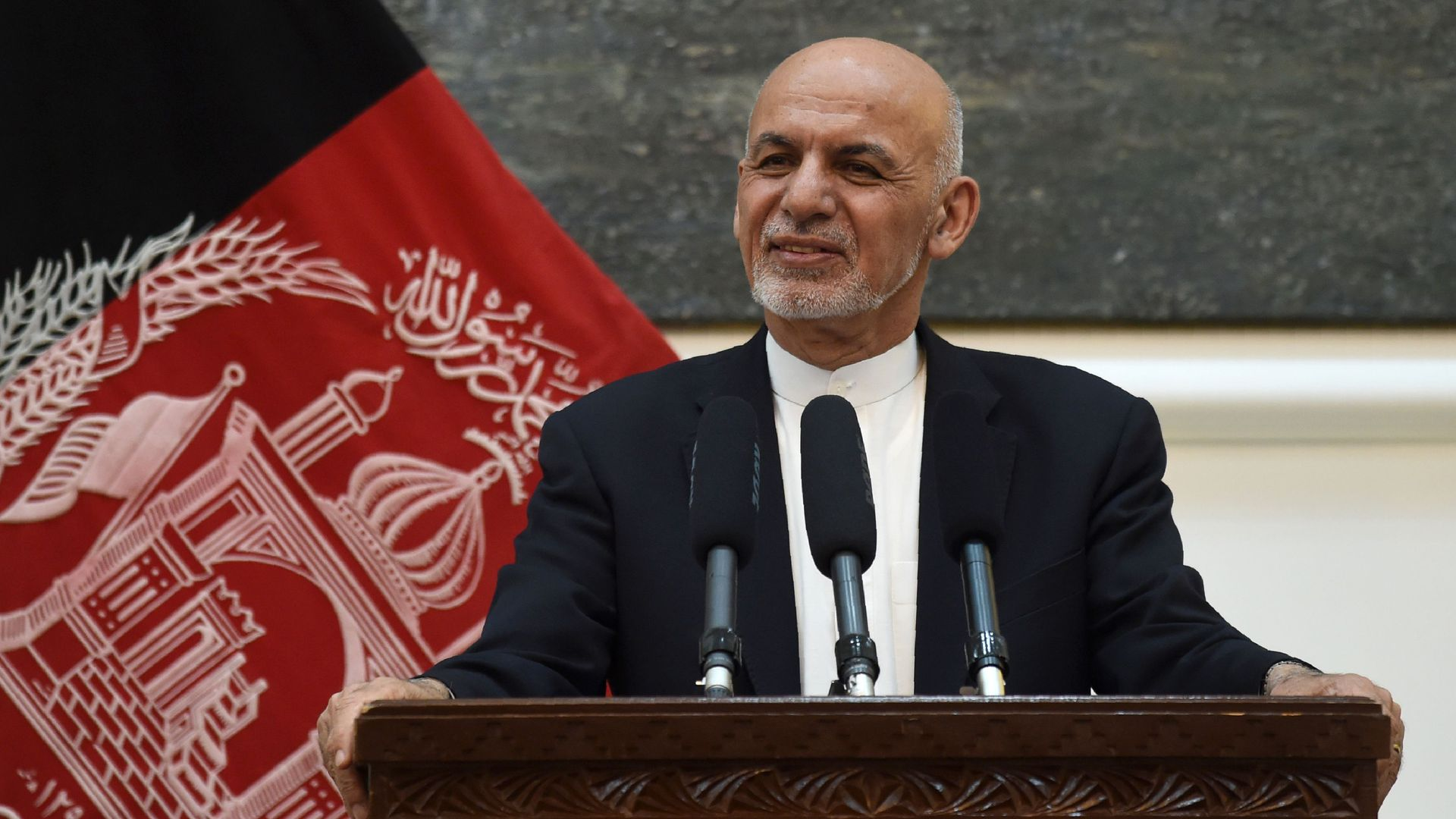 Afghan President Ashraf Ghani listens to US Secretary of State Mike Pompeo during a press conference at the Presidential Palace in Kabul