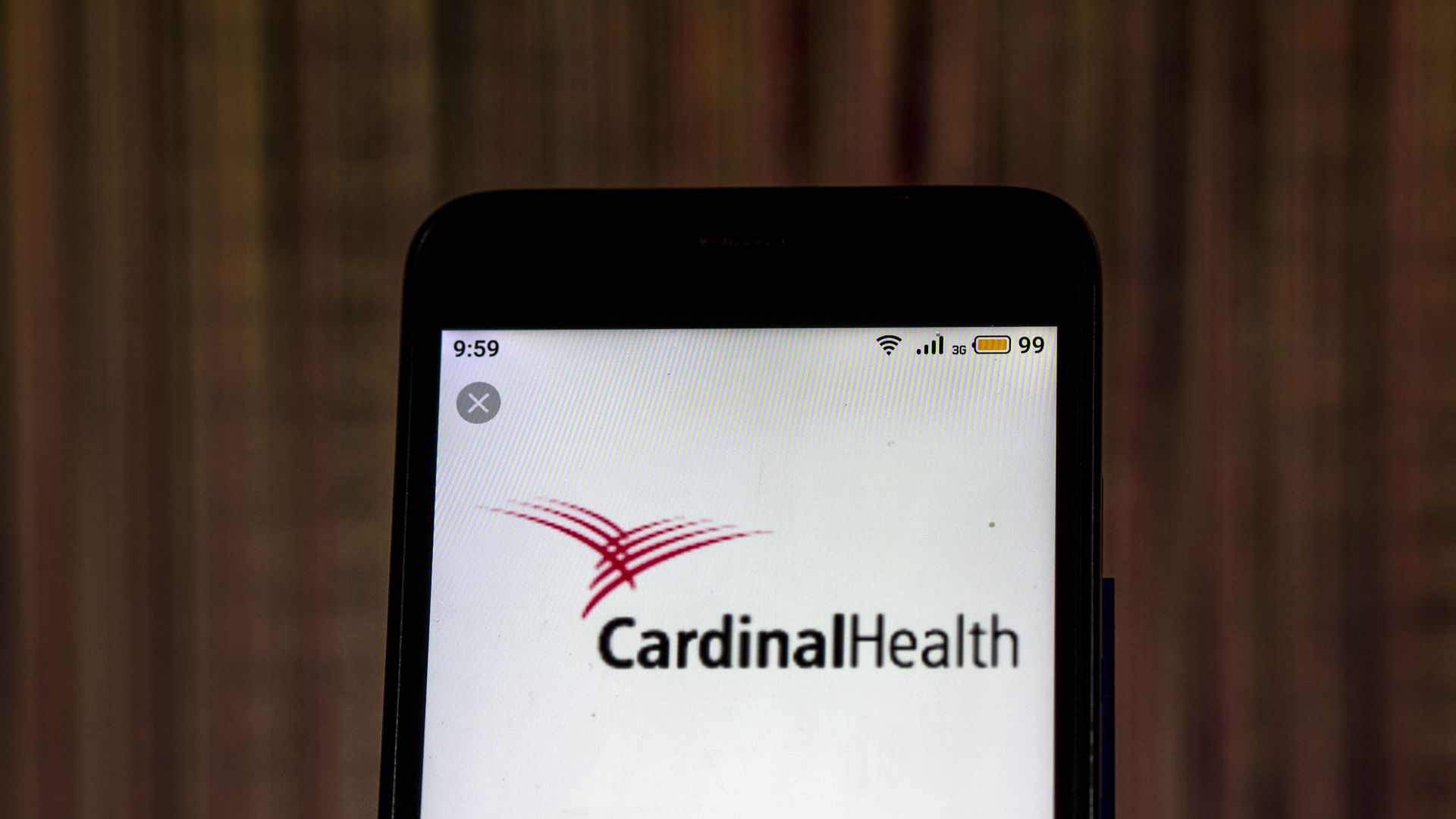 A smart phone with the Cardinal Health logo on the screen.
