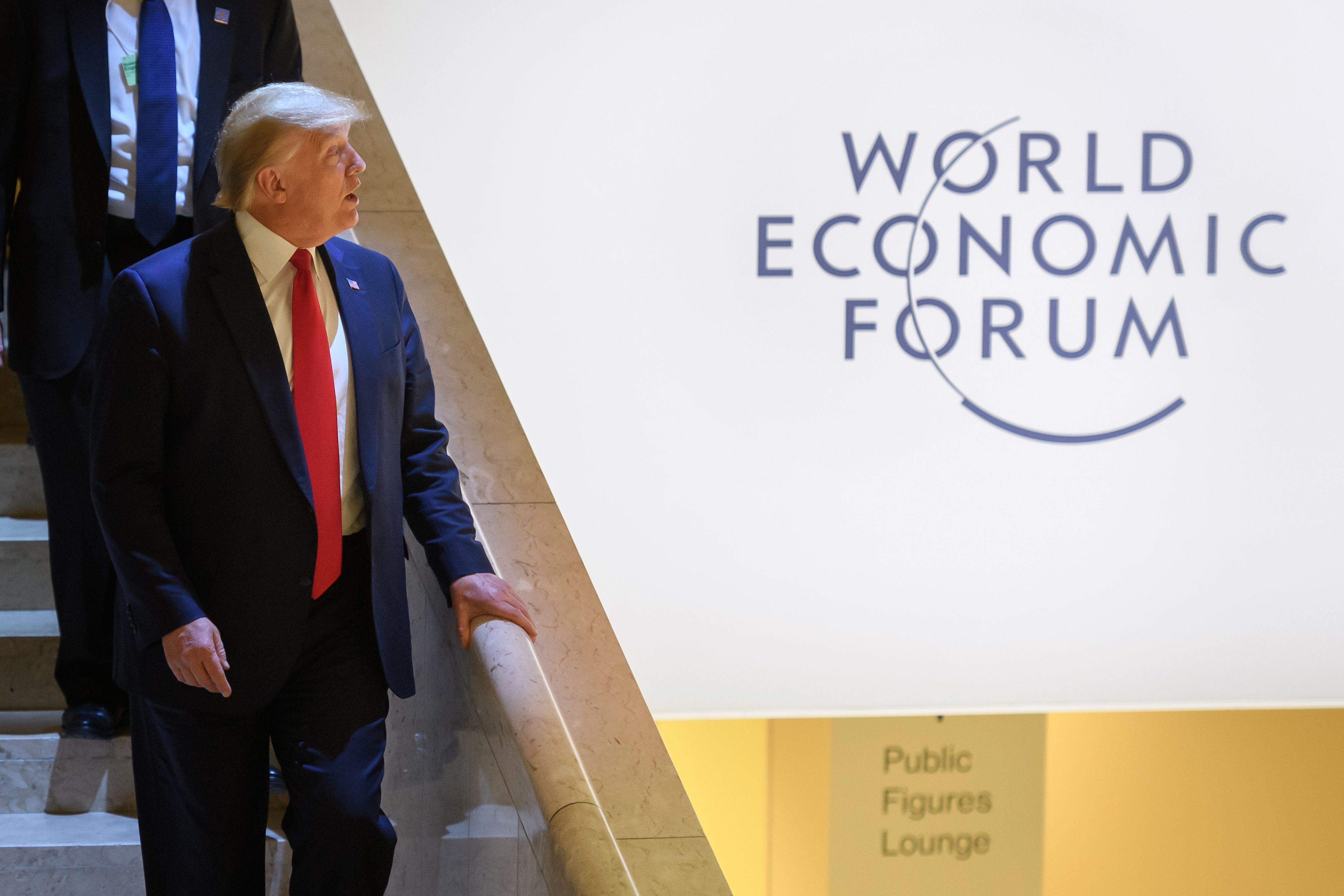 Trump meets with Apple's Cook and other tech execs in Davos - Axios