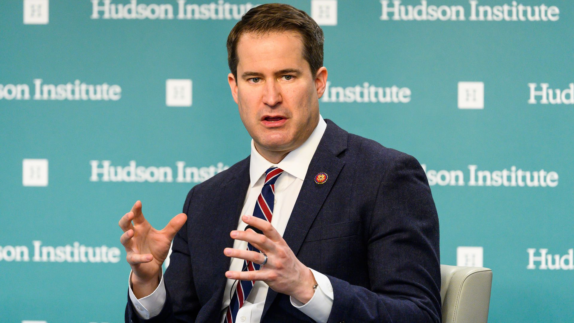 Seth Moulton sitting and gesturing with his hands.
