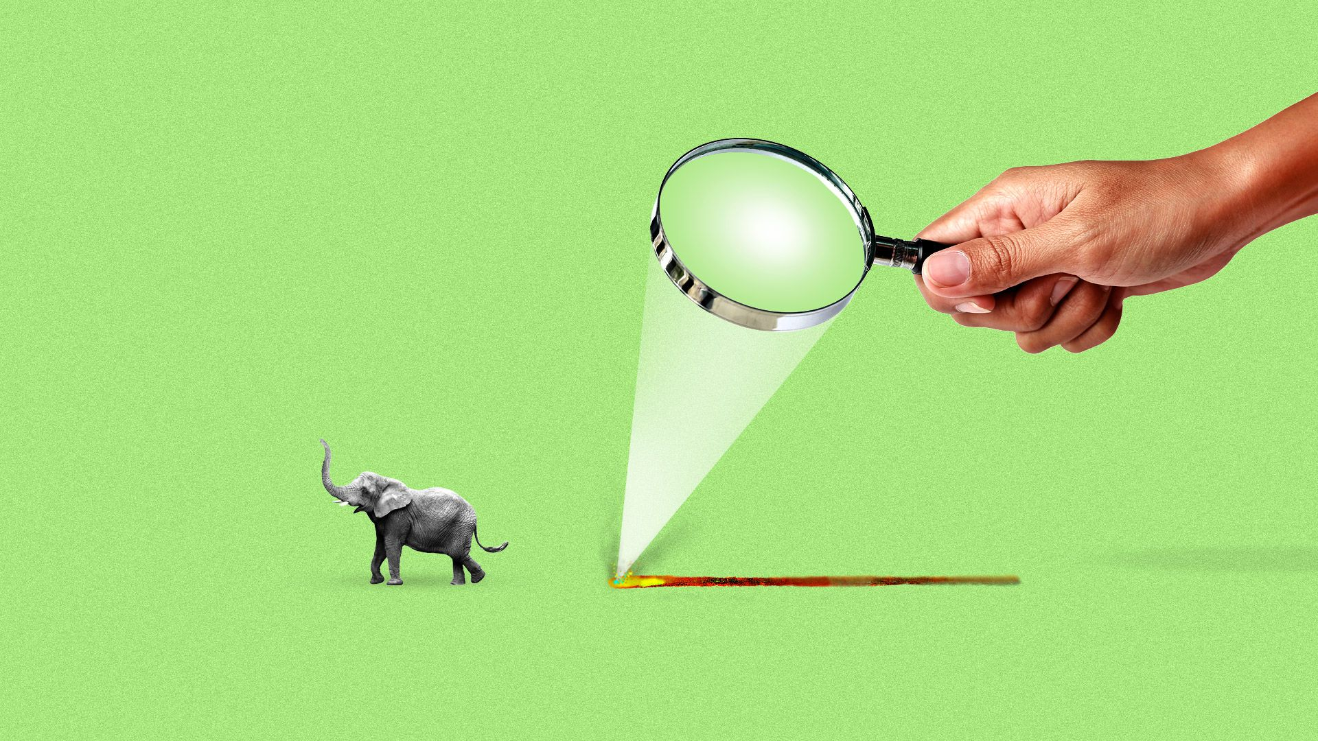 A tiny elephant runs away from a trail of fire caused by a man focusing the sun through a magnifying glass.