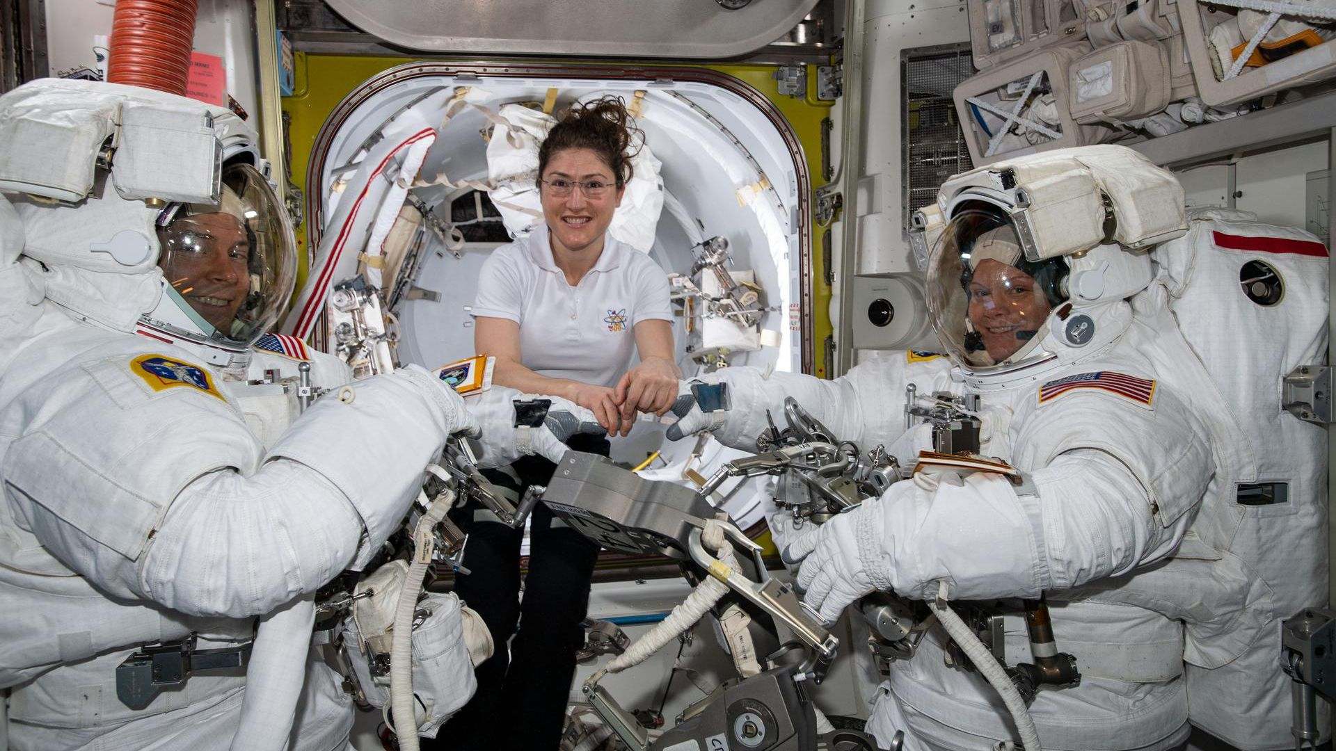 NASA astronauts Nick Hague (L), Christina Koch (C), and Anne McClain (R)