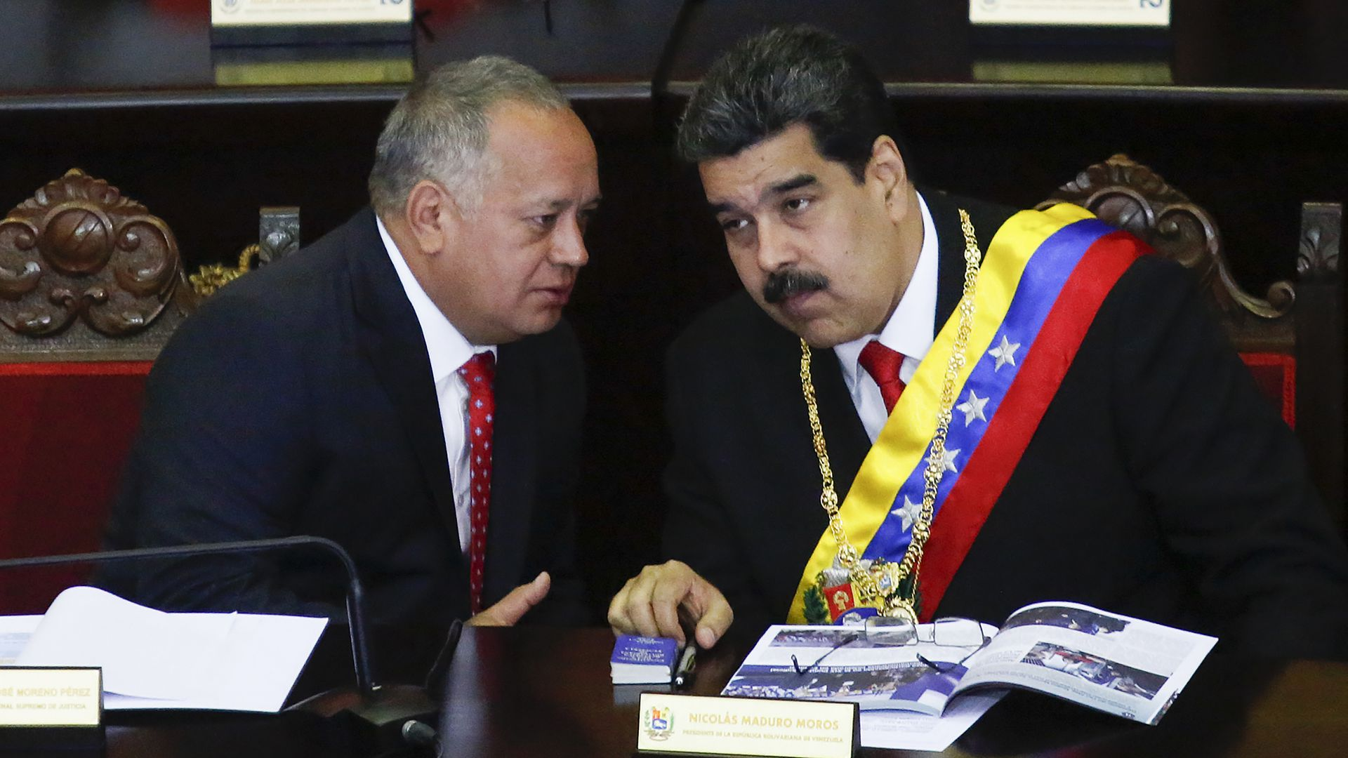 President of Venezuela Nicolás Maduro (R) talks to President of the Constituent Assembly Diosdado Cabello (L)