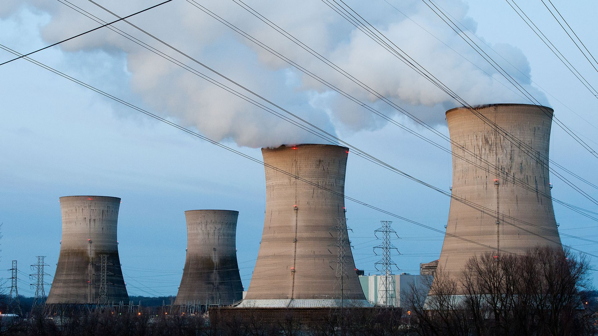 In this image, nuclear reactors billow vapor into the air.
