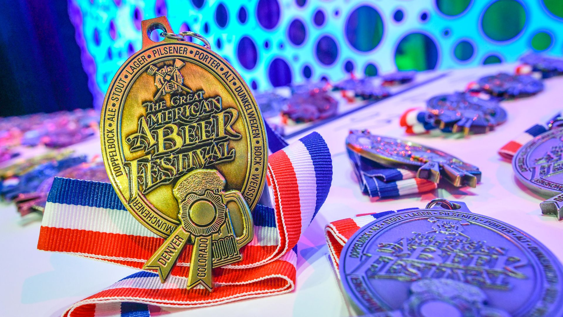 A GABF medal sits on a table ahead of the awards ceremony in 2021. Photo courtesy of the Brewers Association