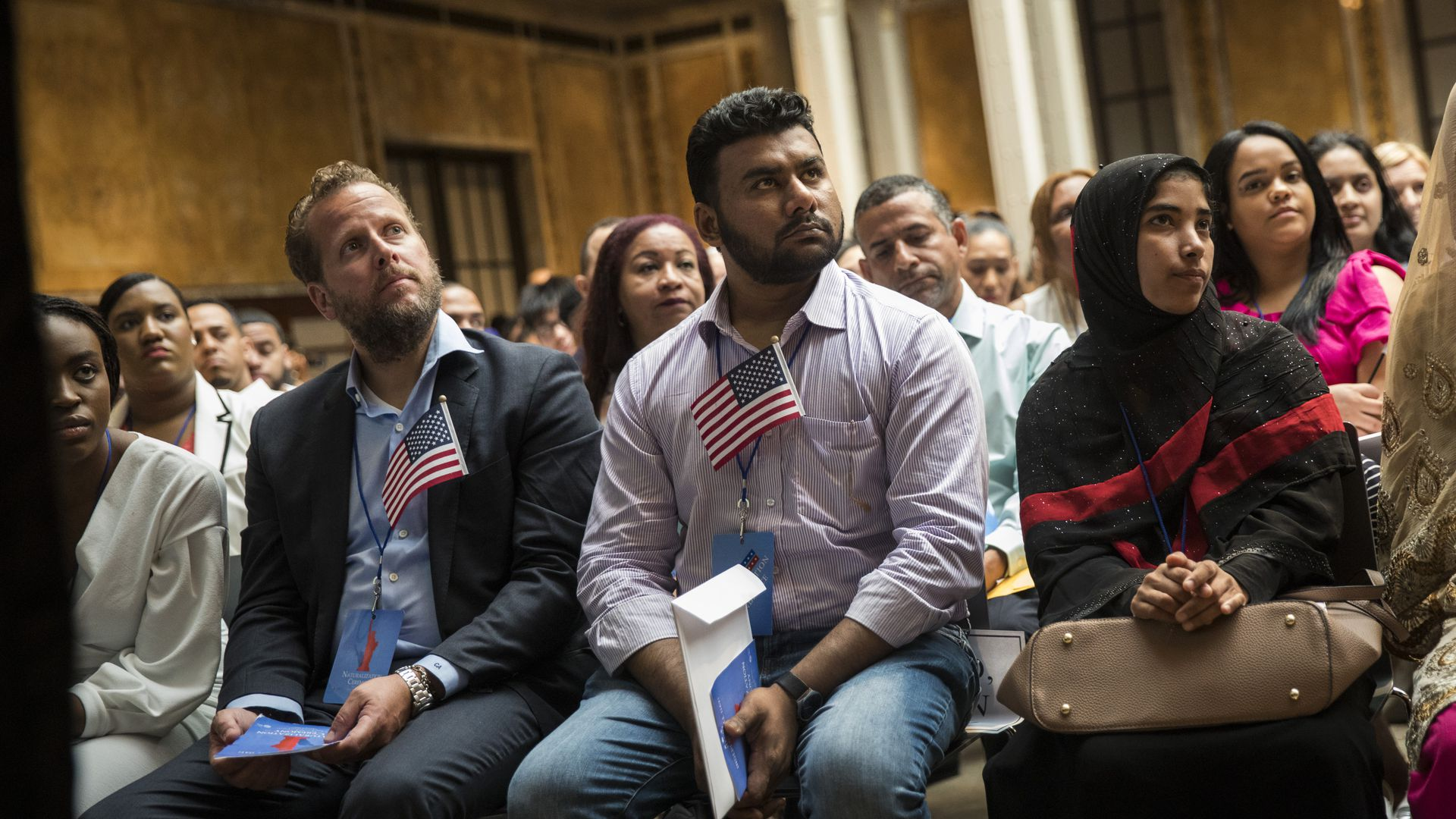 Immigrants participate in a naturalization ceremony to officially become U.S. citizens at the New York Public Library. Photo by Drew Angerer/Getty Images
