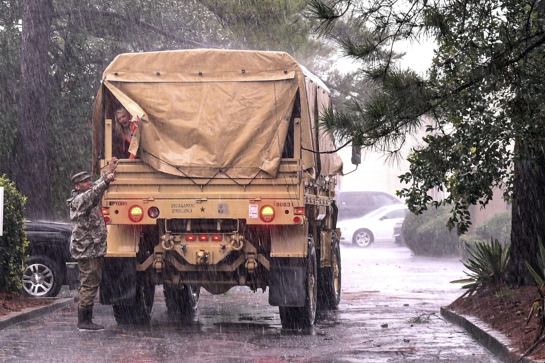 National Guardsmen cover truck in Hurricane Dorian