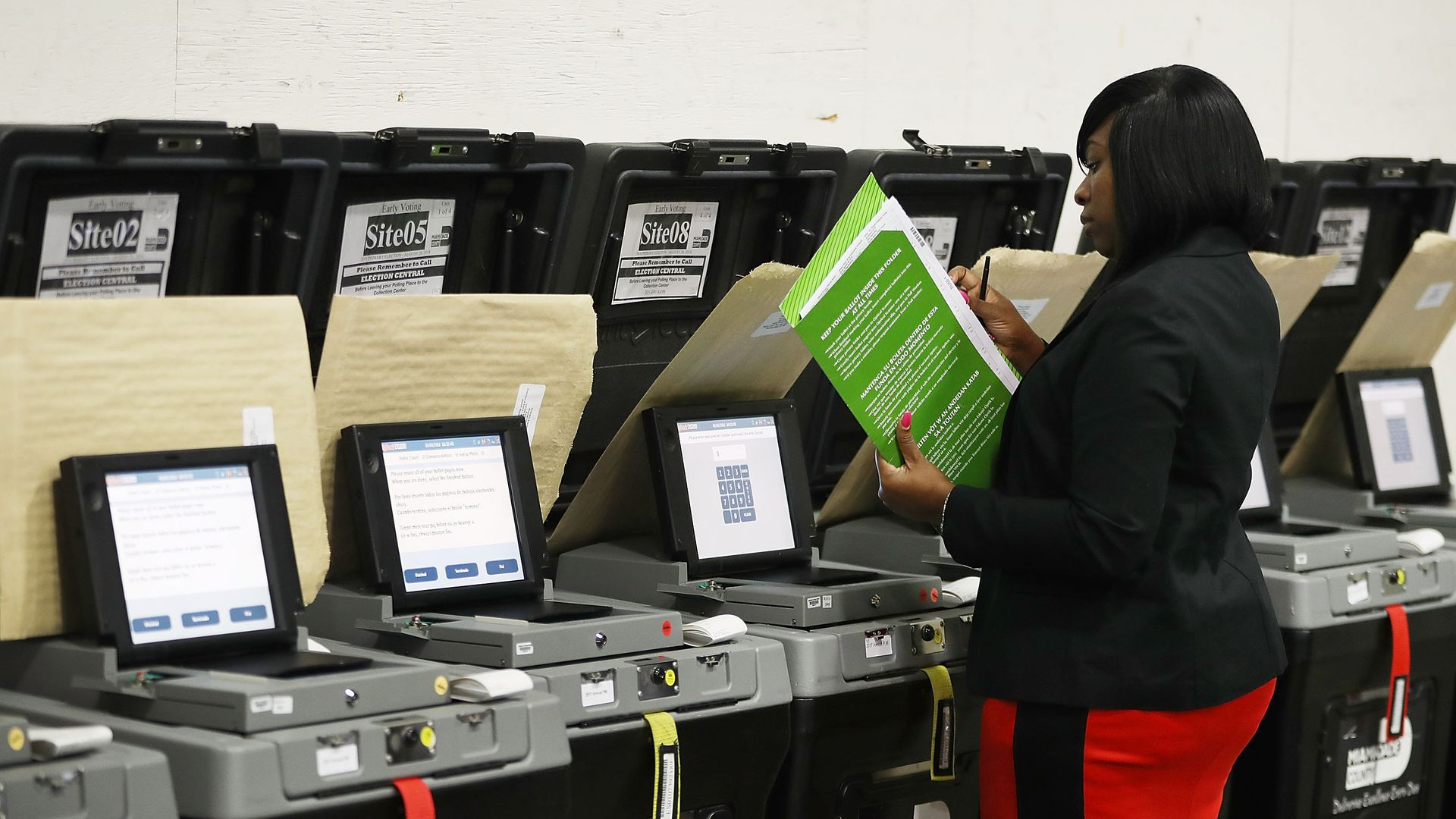 Woman checking voting booths