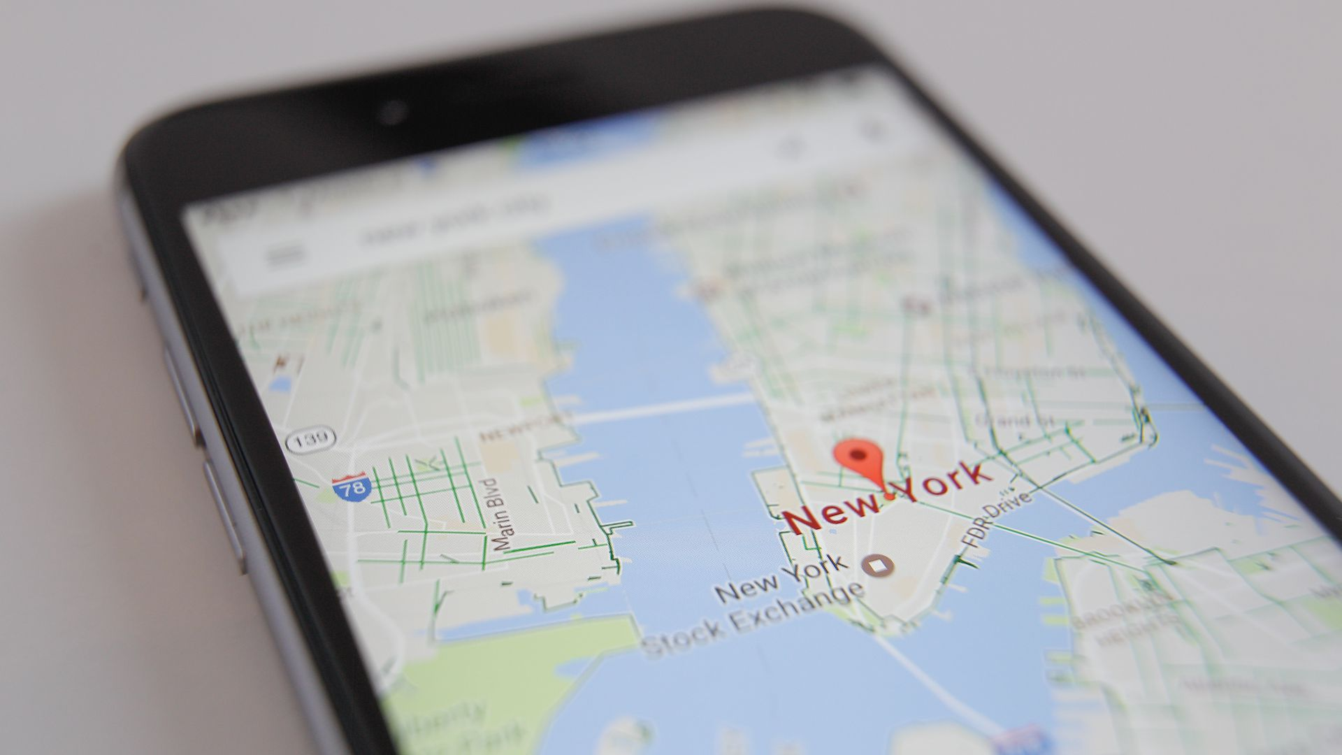 iPhone screen with Google Maps centered on Manhattan