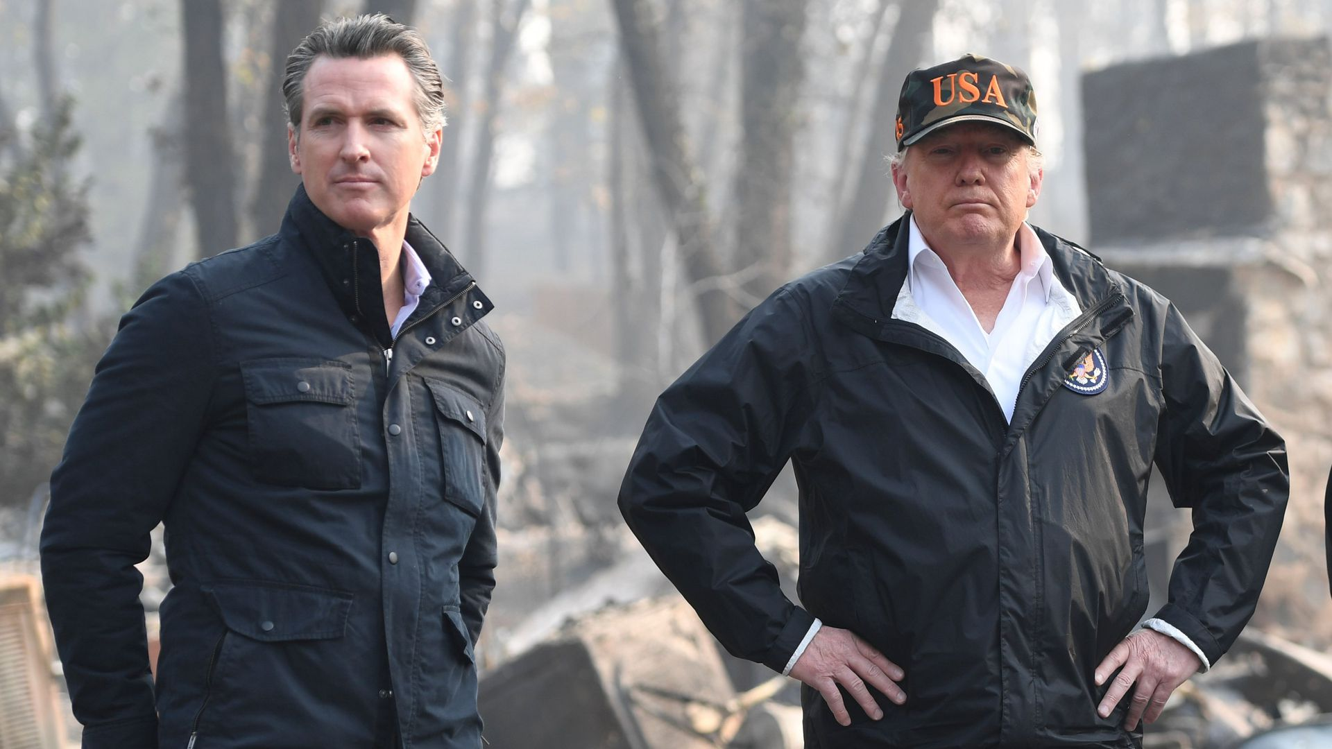 President Donald Trump with Governor of California, Gavin Newsom, as they view damage from wildfires in Paradise, California on November 17, 2018.