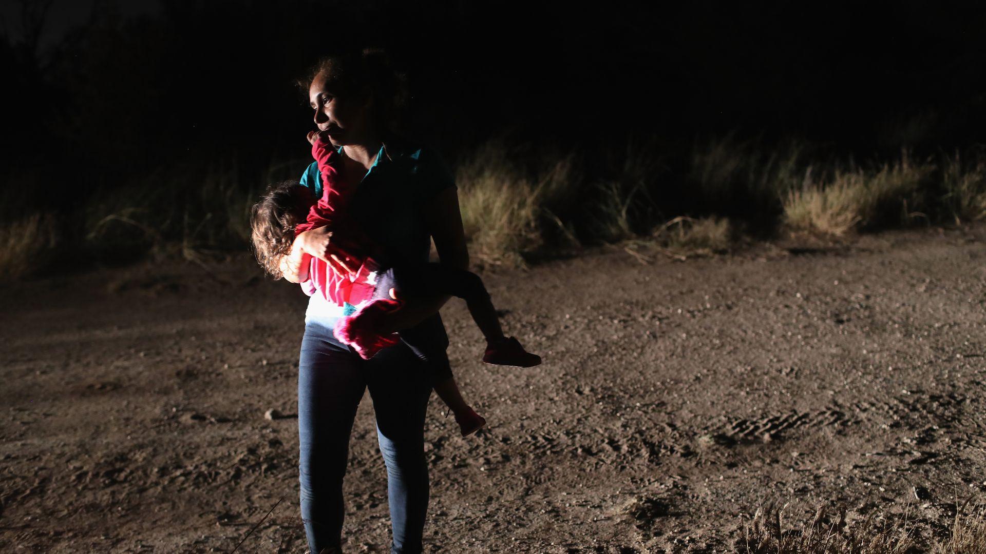 Border patrol agents detaining migrants