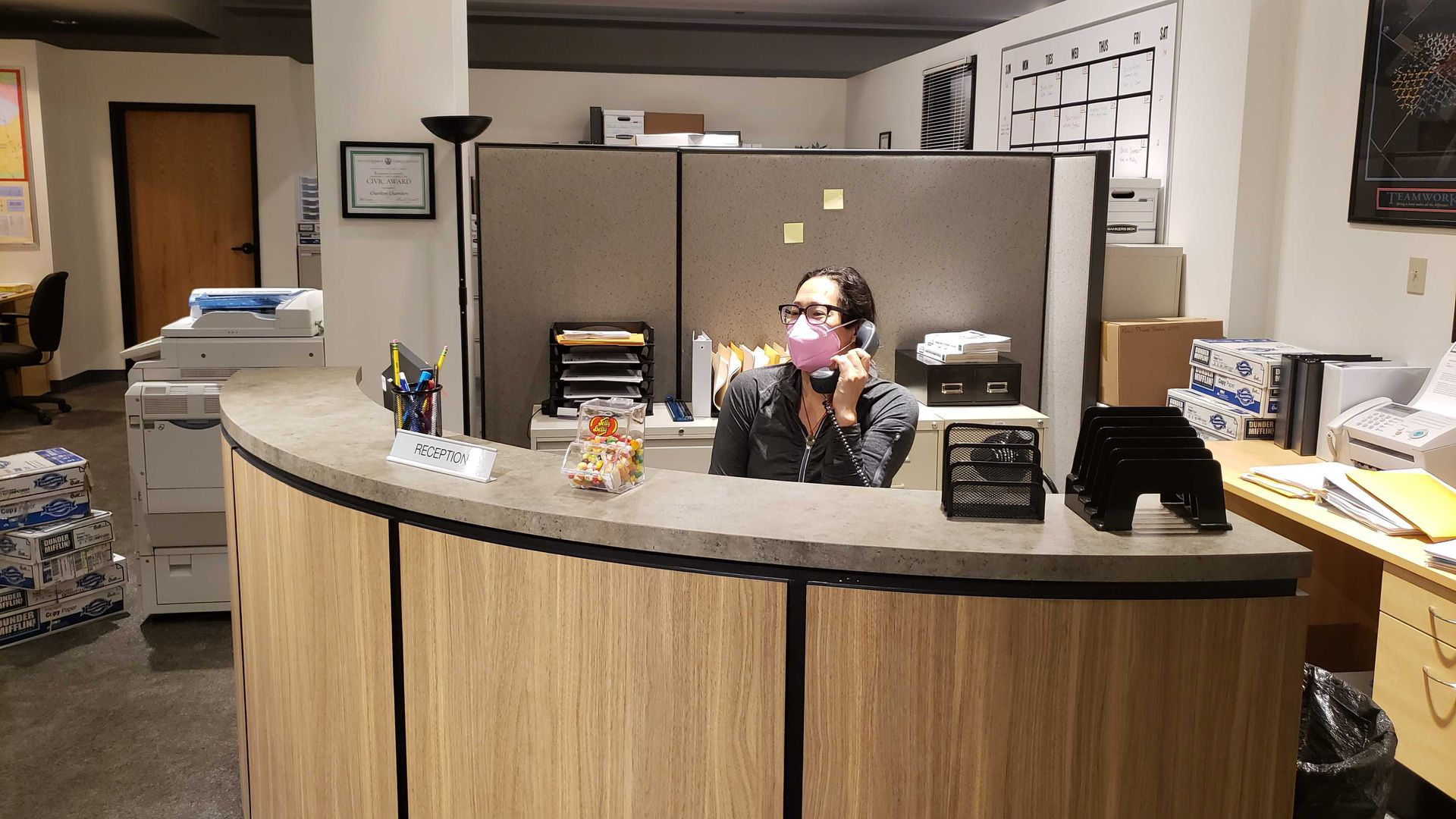 Woman at reception desk.