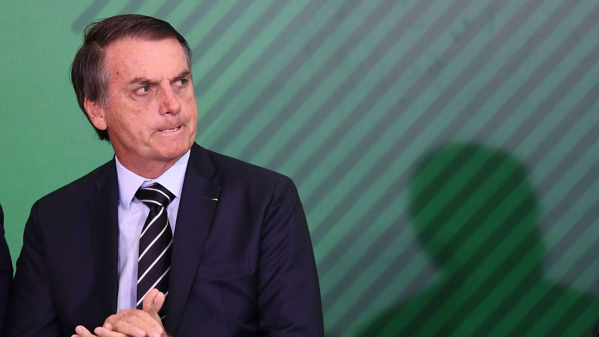 Jair Bolsonaro looks mad.