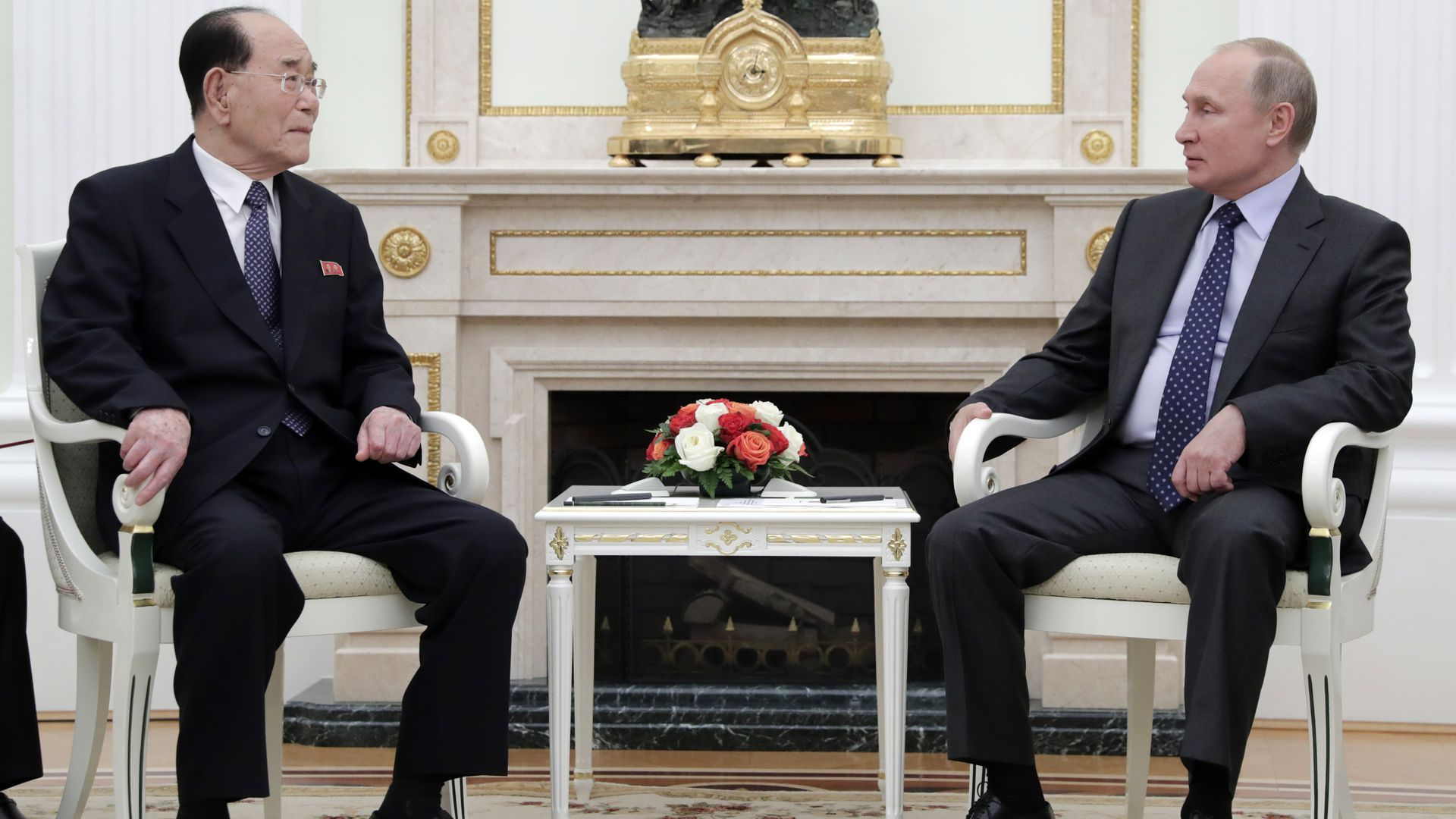 Kim Yong-nam, president of the Presidium of Supreme People's Assembly of North Korea, sits to the left of Russian President Vladimir Putin