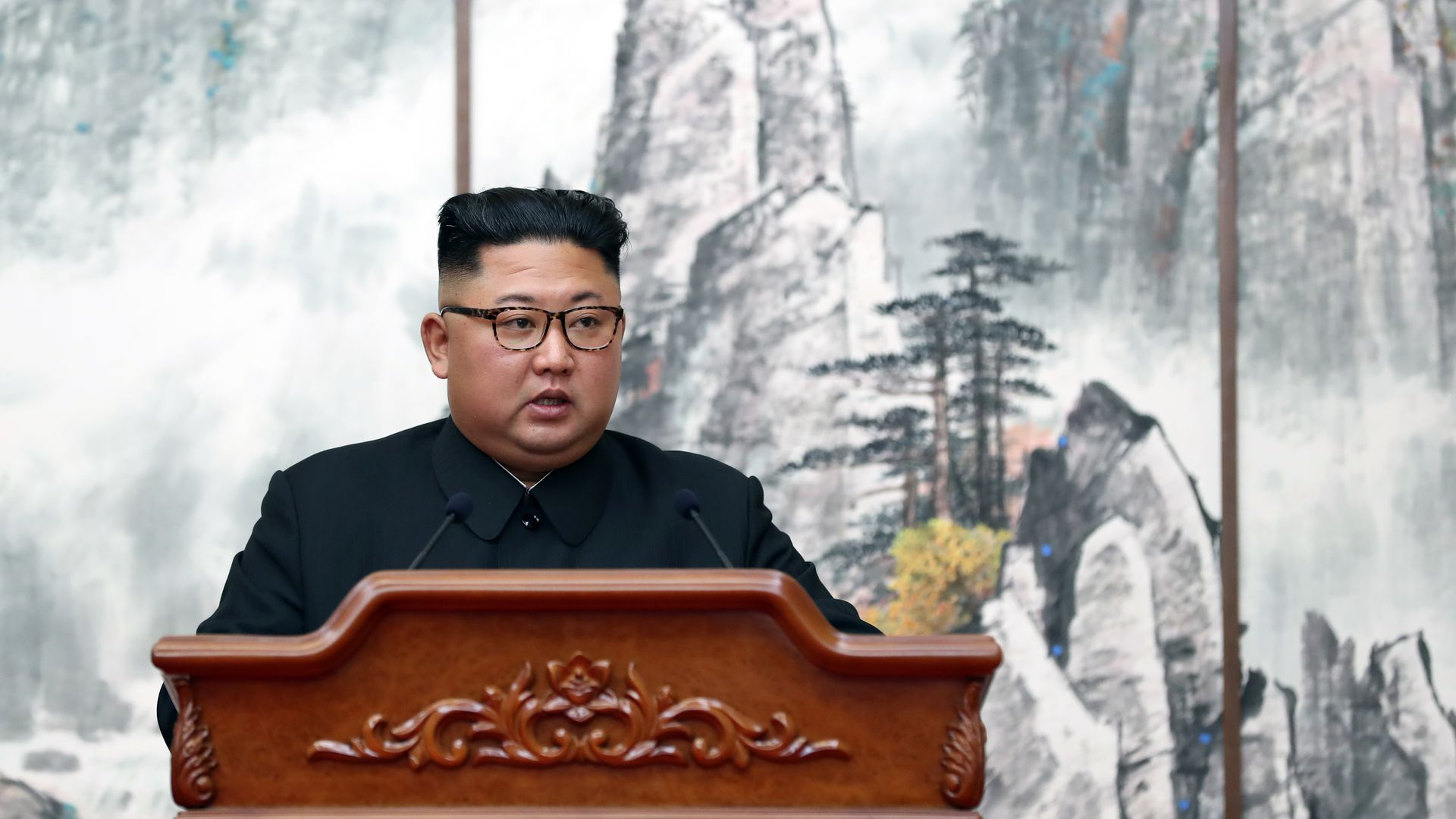 North Korean leader Kim Jong-Un speaking at a podium