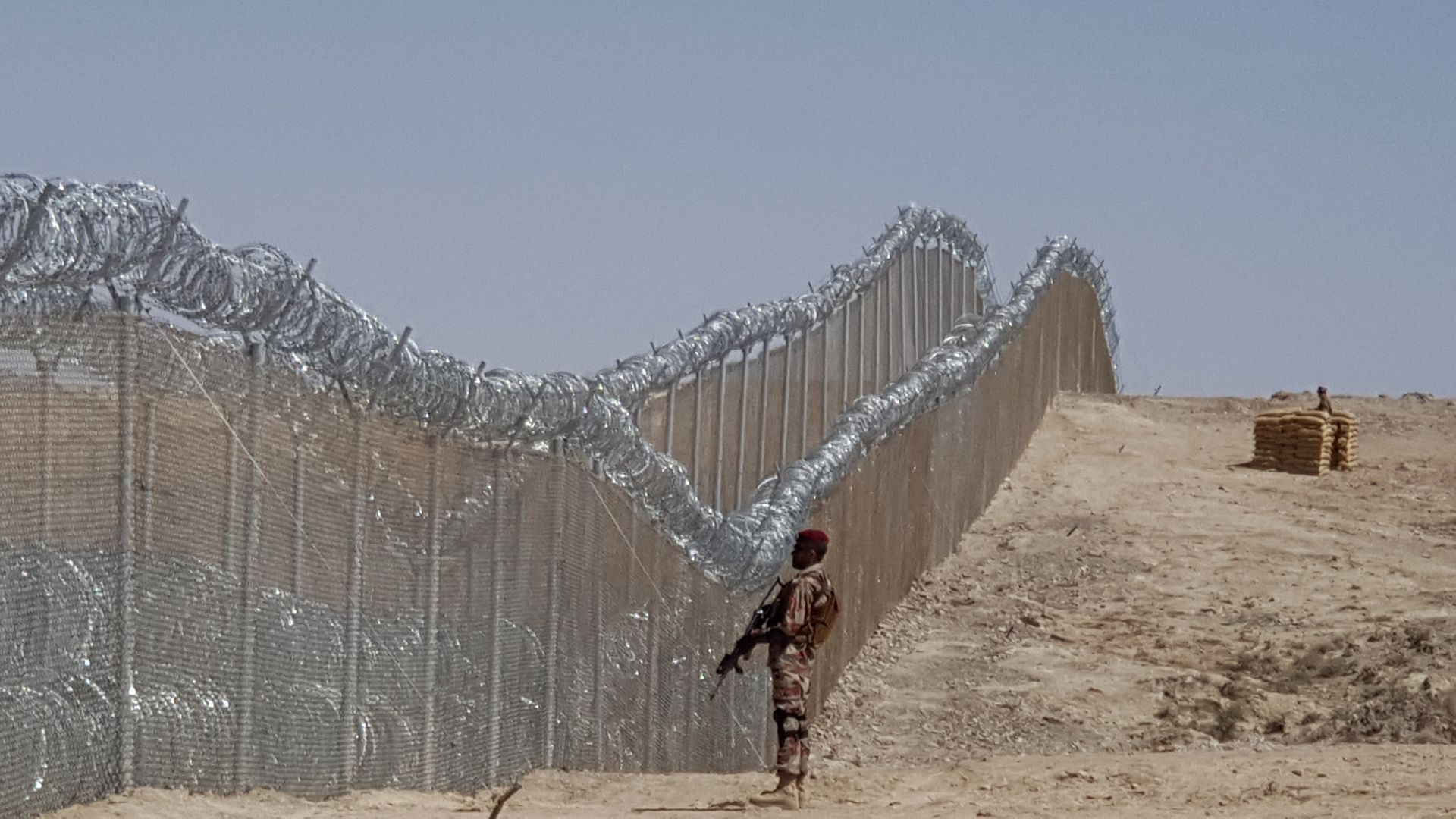 A Pakistani army soldier stands guard along with border fence at the Pak-Afghan border near the Punjpai area of Quetta in Balochistan on May 8, 2018.