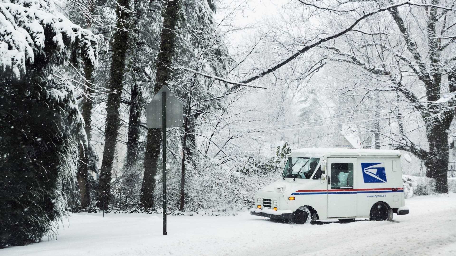 Mail delivery truck in the snow