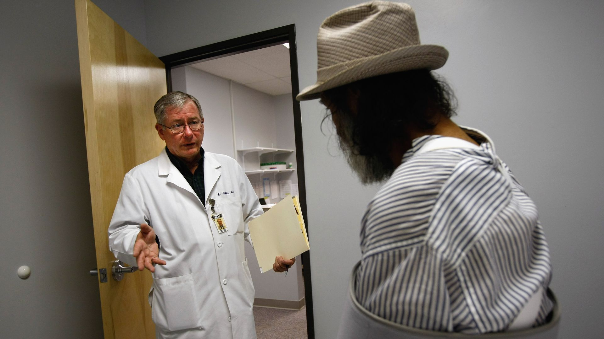 A doctor speaks with a Medicaid patient in a clinic.