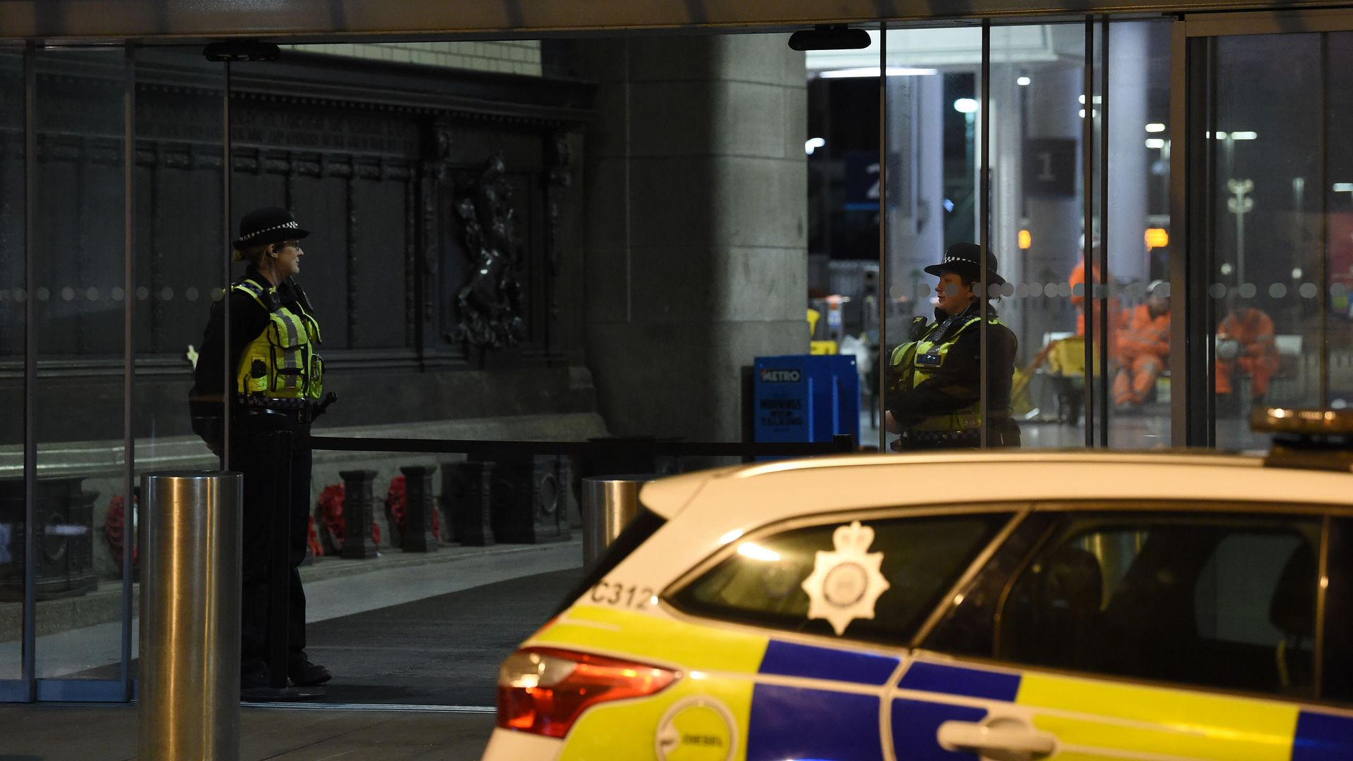 British police officers stand near a cordon at Manchester Victoria Station, in Manchester on January 1, 2019, following a stabbing on New Year's Eve.