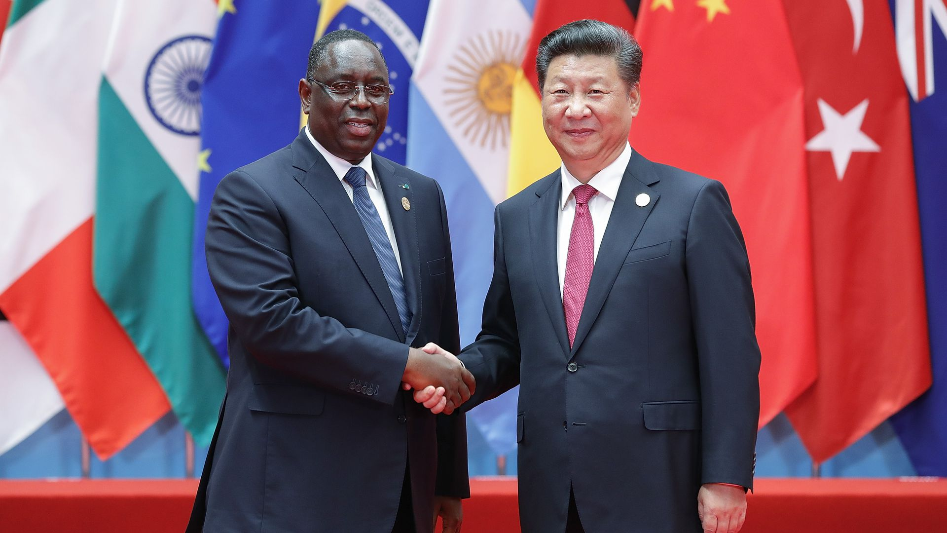 Chinese President Xi Jinping shakes hands with Senegalese President Macky Sall at the G20 Summit.