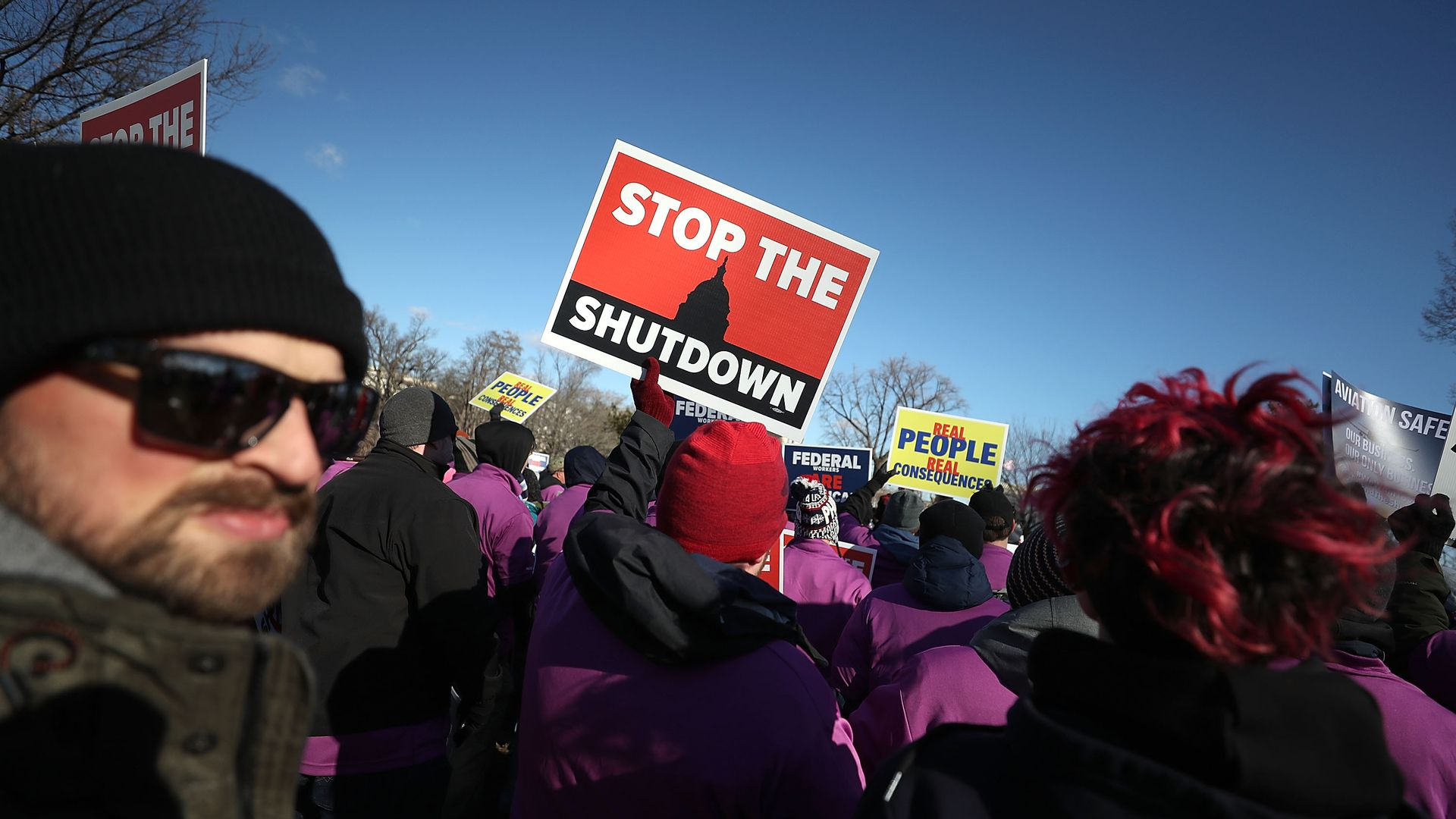 People rally against the partial federal government shutdown outside the U.S. Capitol