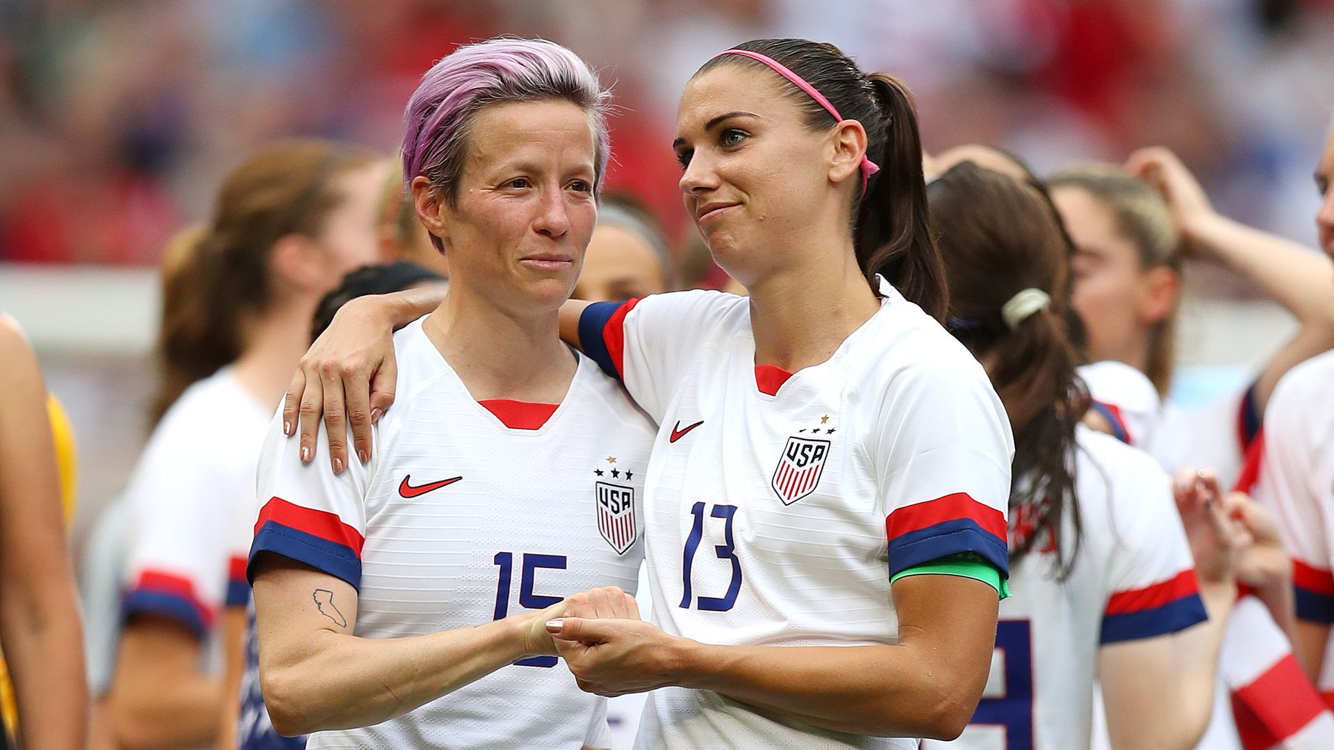 Megan Rapinoe and Alex Morgan celebrate after the 2019 FIFA Women's World Cup France Final match between The United State of America and The Netherlands at Stade de Lyon