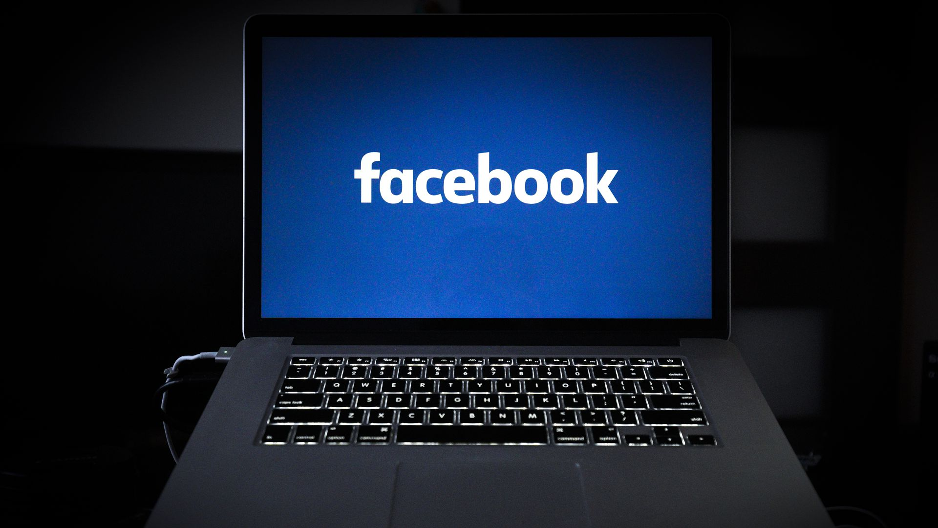 laptop with facebook logo on it