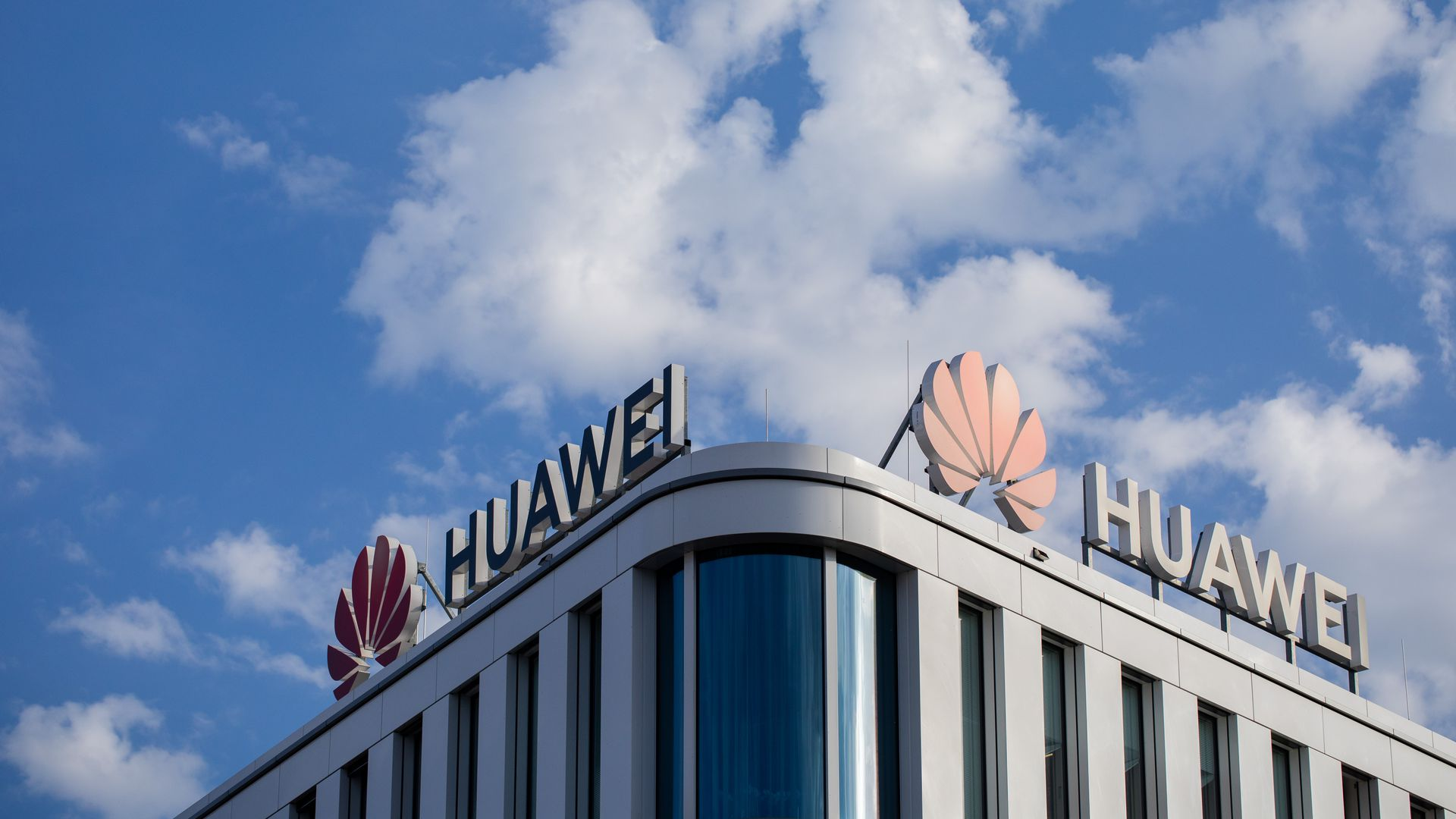 This image shows a rooftop with two Huawei logos on either side of its roof