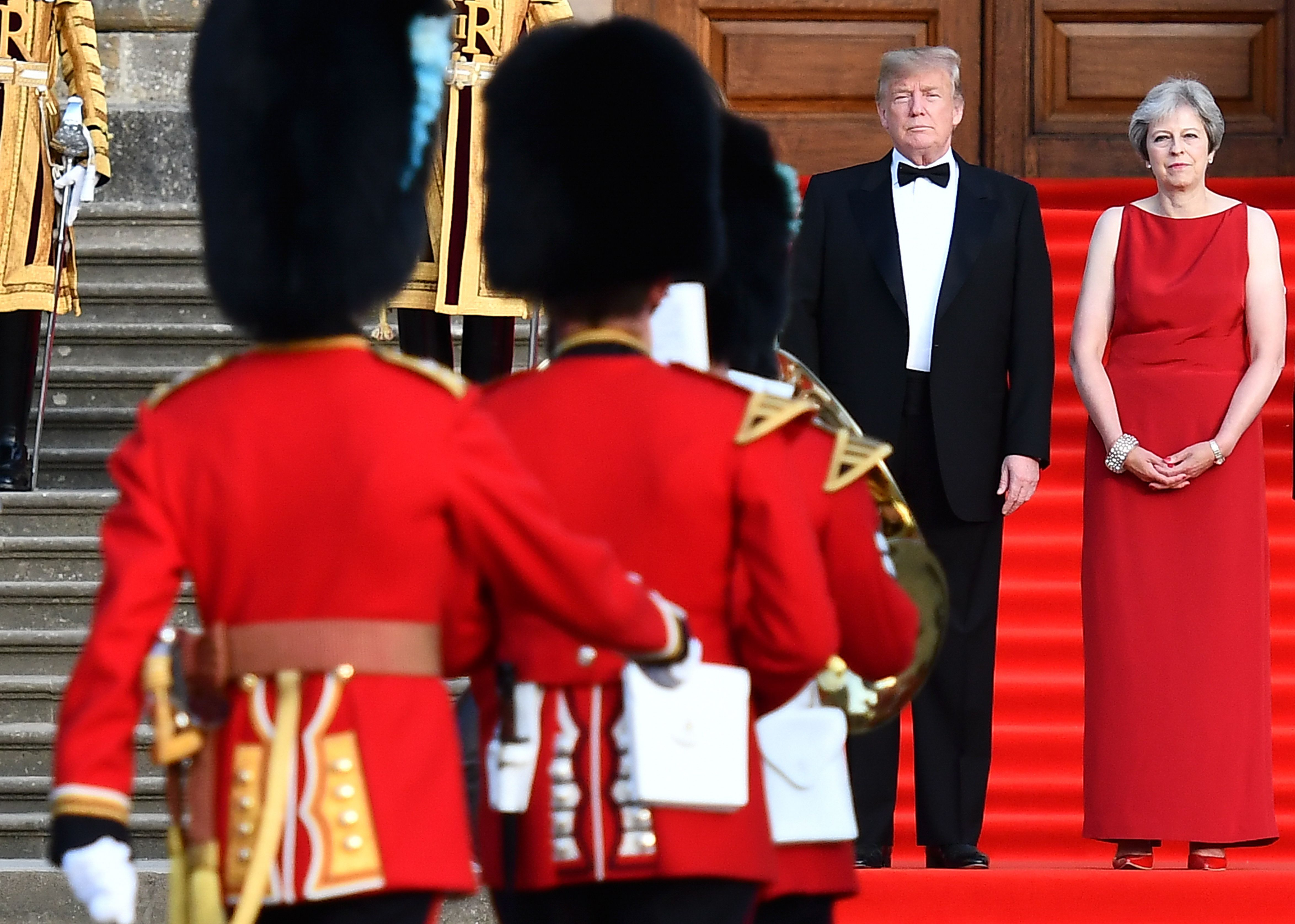 Trump stands with Theresa May on the steps of the Great Court