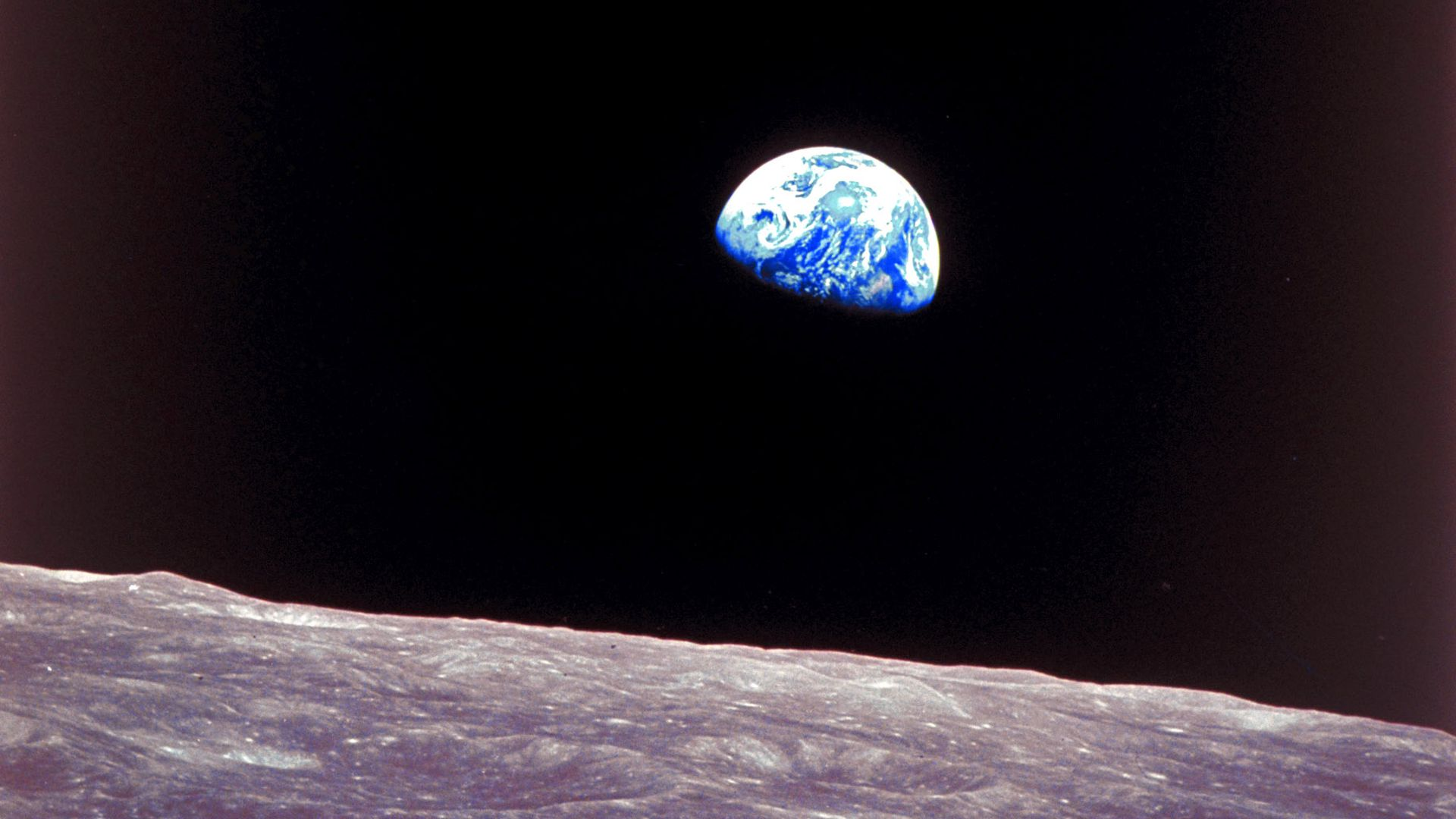 Apollo 8 photo of the earth rising over the moon