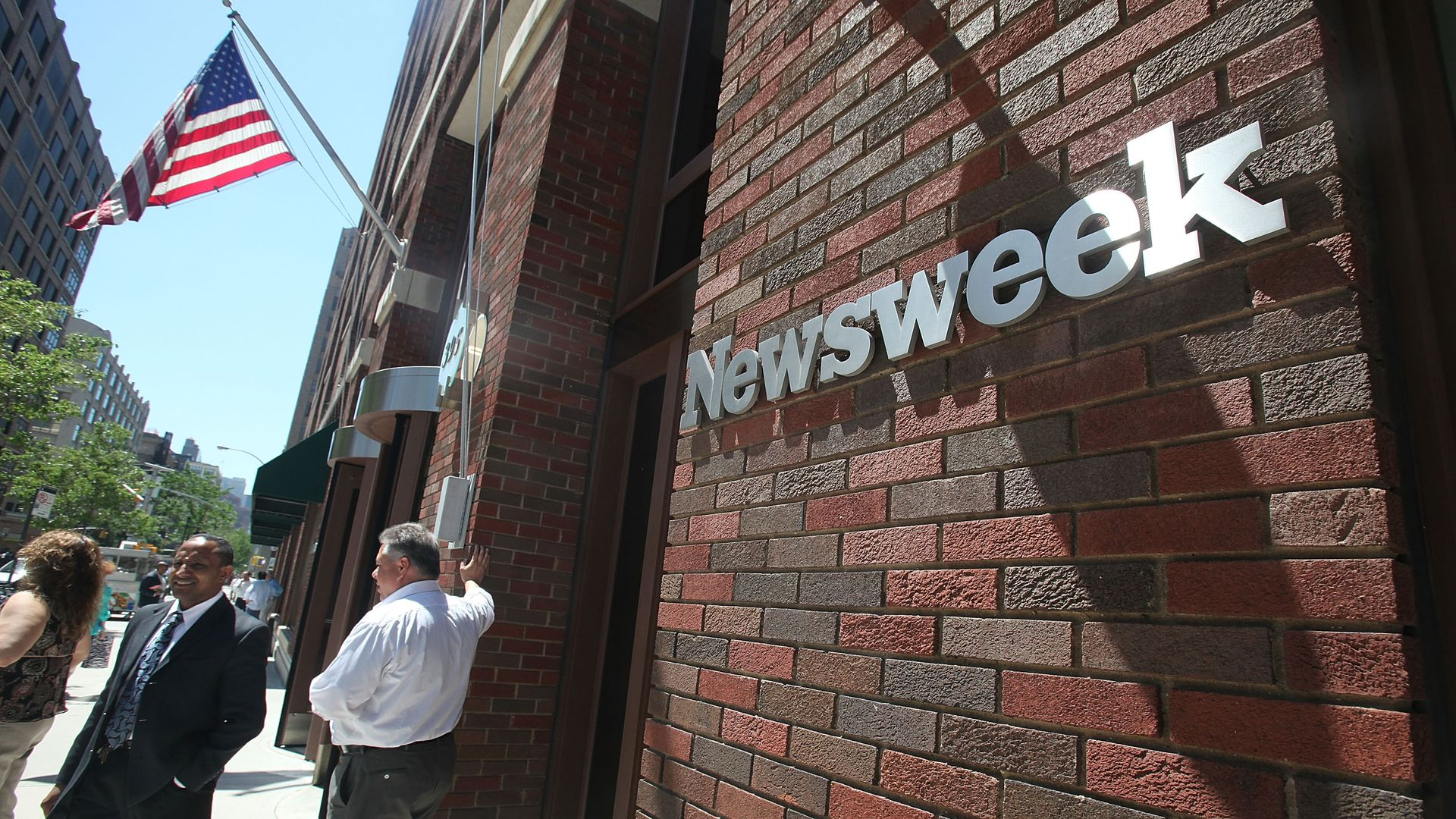 A sign bearing the Newsweek logo