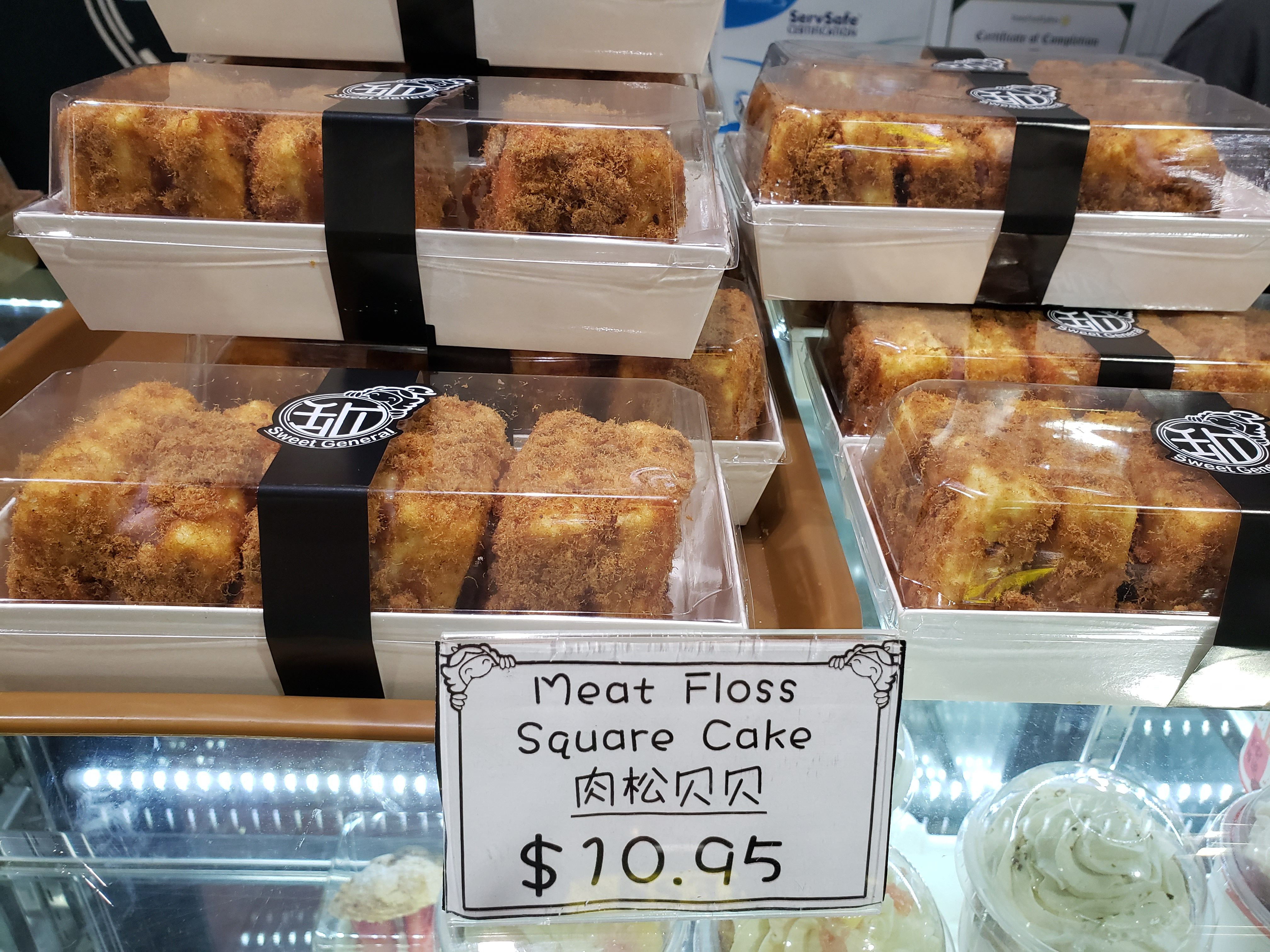 Square cakes with brown topping.