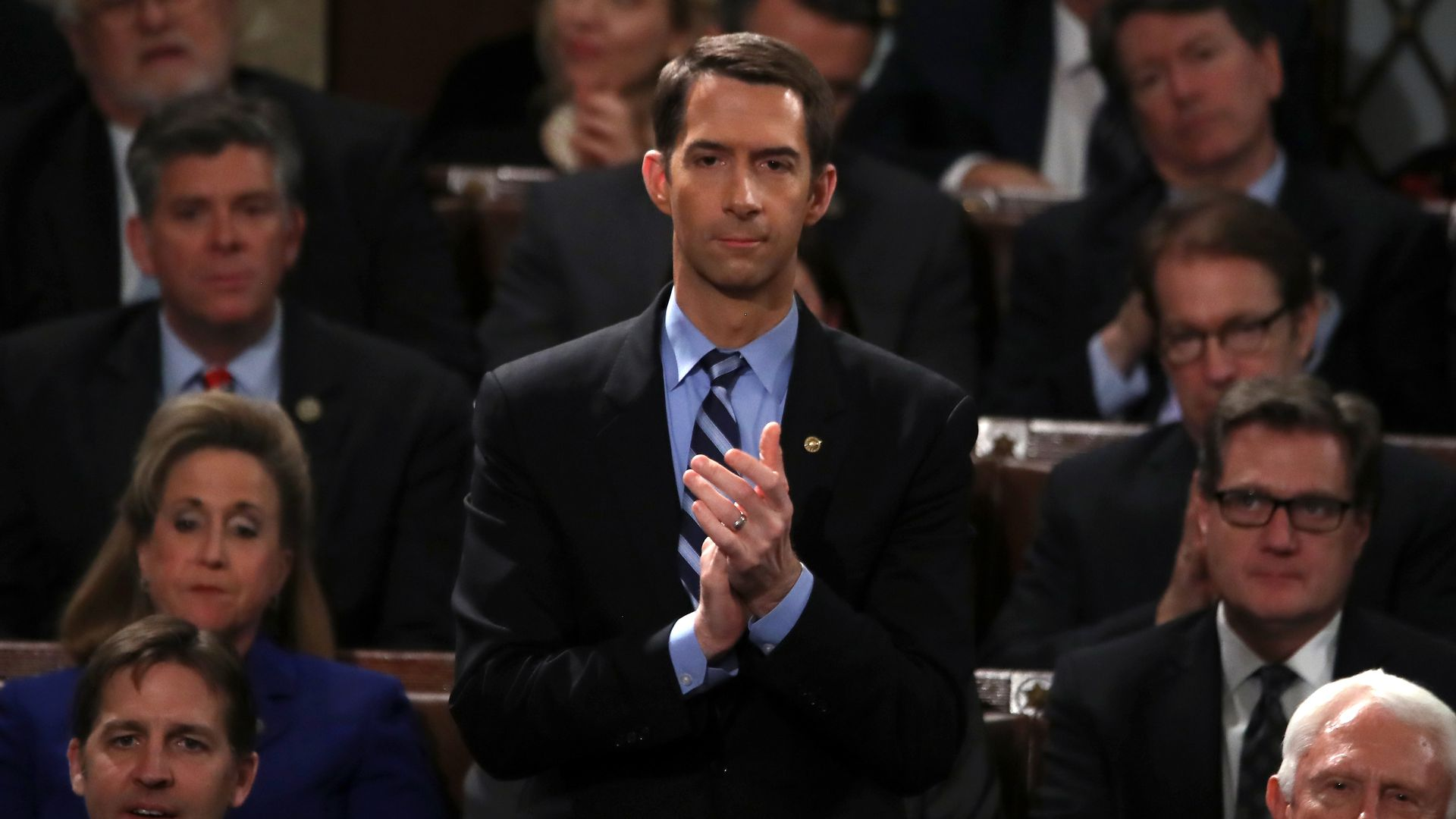 Tom Cotton standing and clapping.