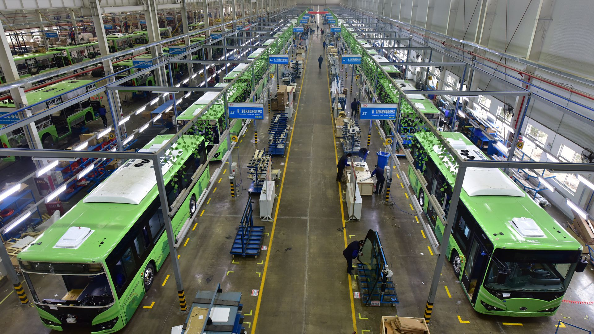 Employees work on the assembly line of the electric bus at a BYD's production base on January 23, 2018 in Xi an, Shaanxi Province of China