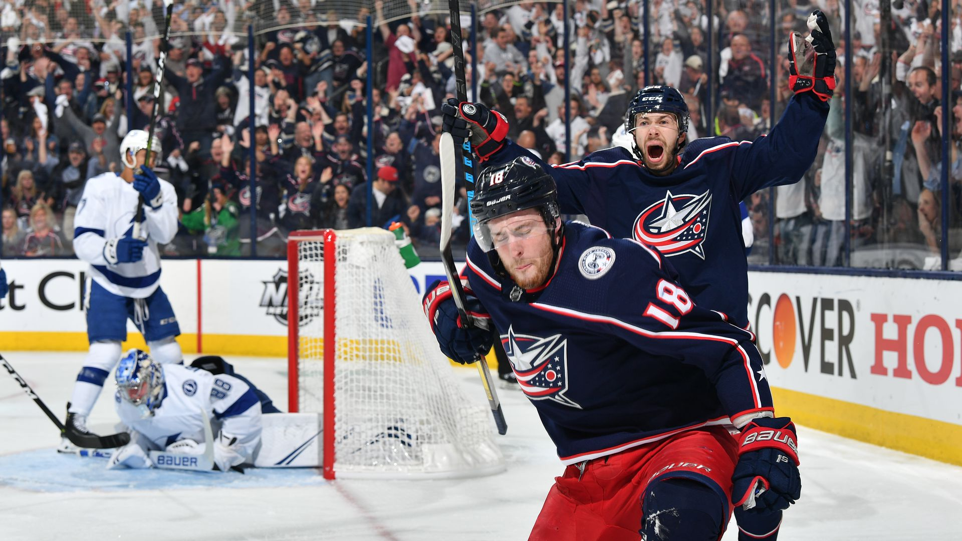 Blue Jackets players celebrating a goal