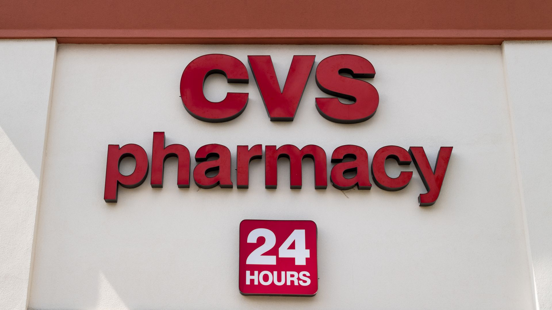 "This image shows a CVS pharmacy sign that also says ""24 hours"""