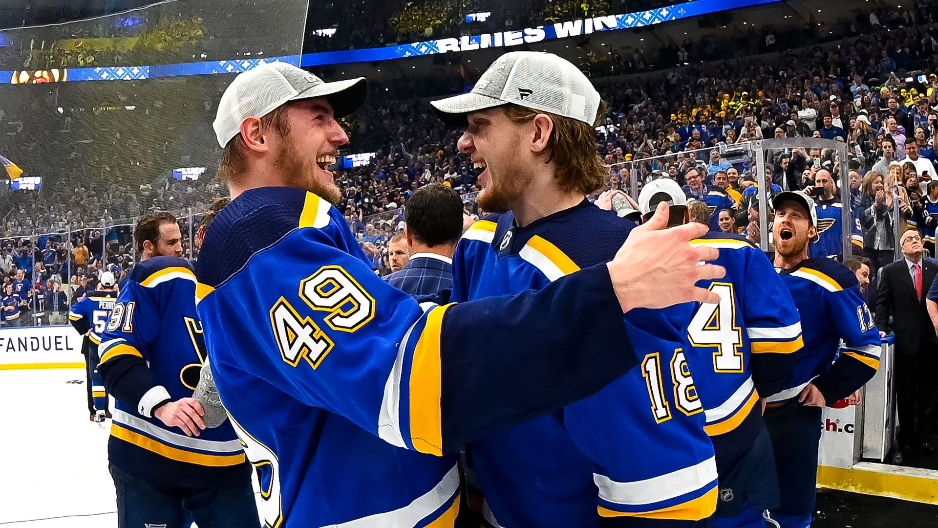Blues players hugging each other