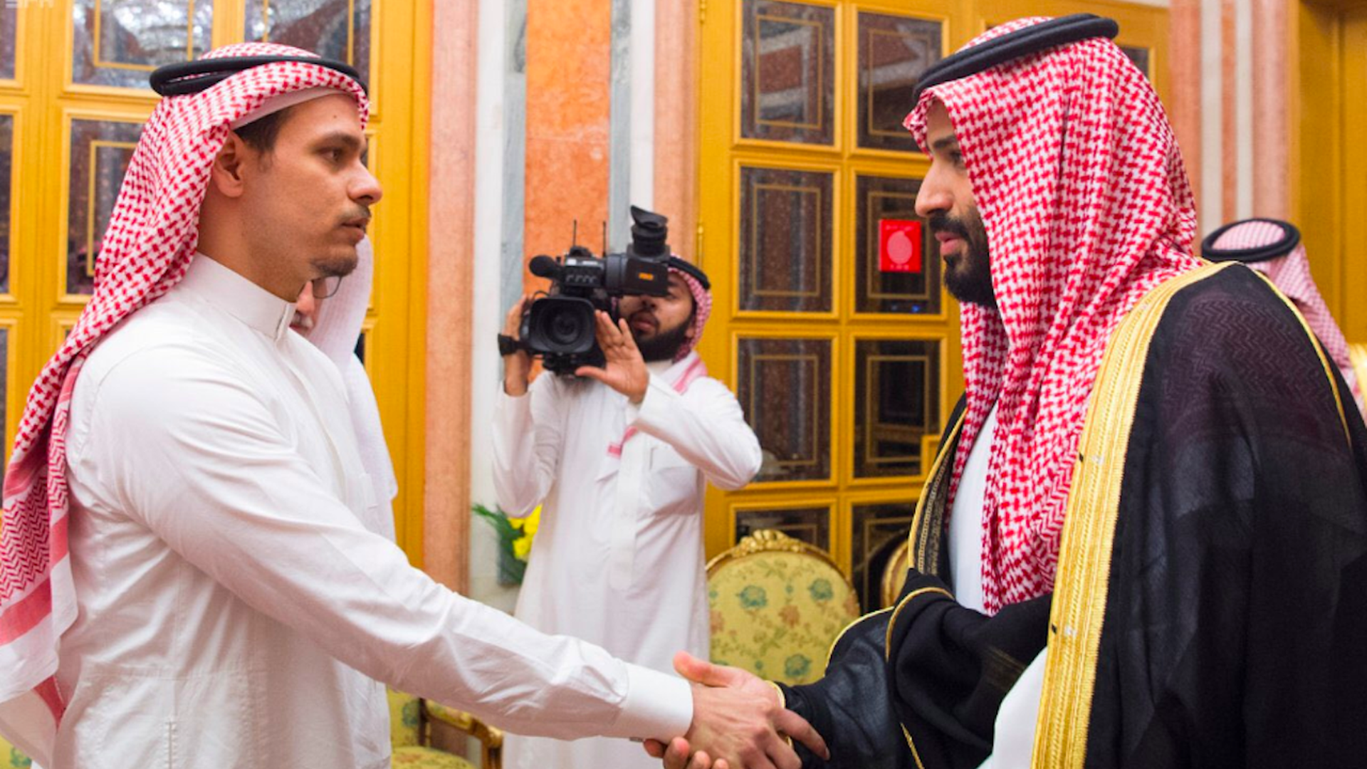 Salah Khashoggi shaking hands with MBS.