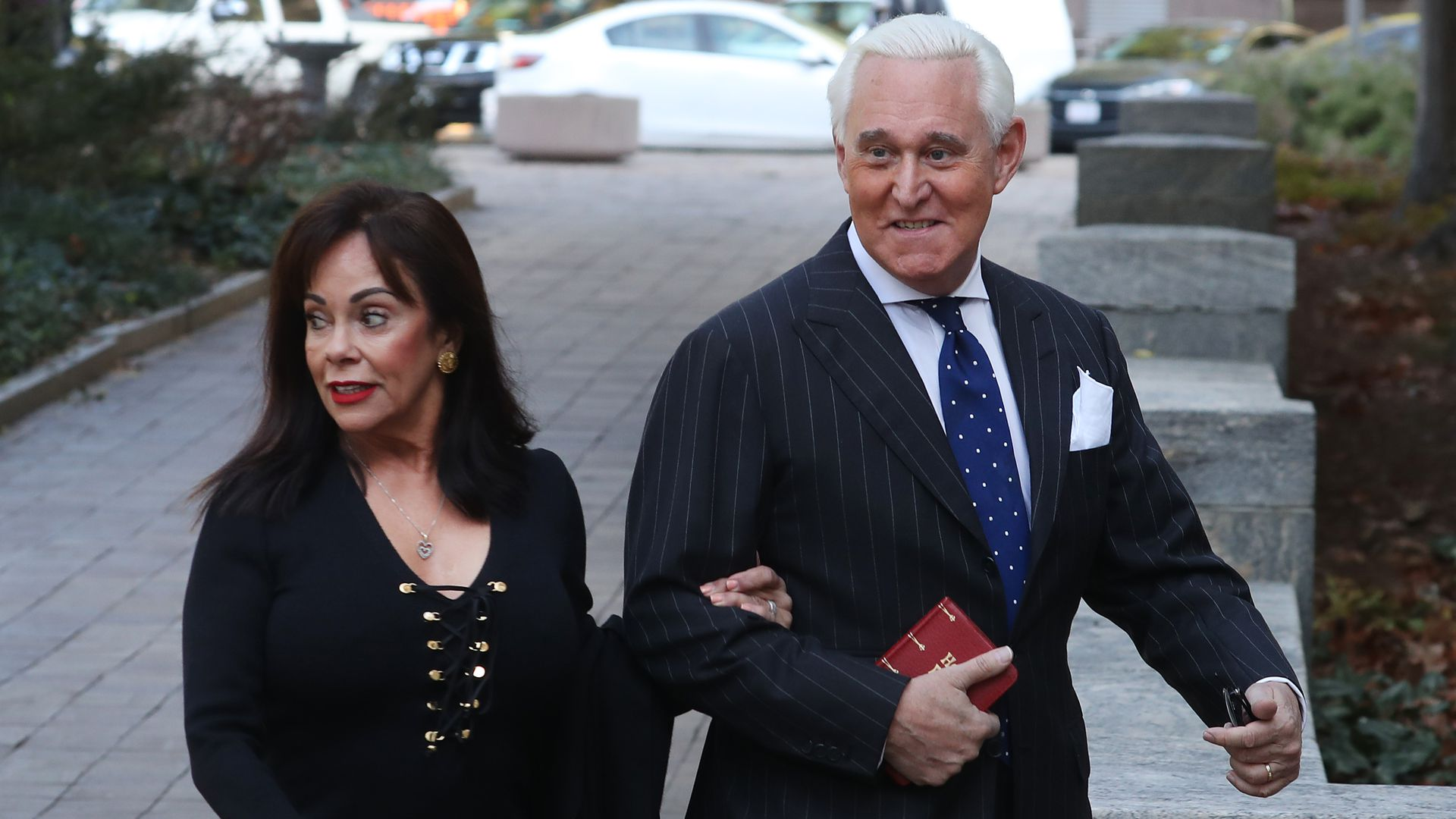 Roger stone walks into the courtroom with his wife.