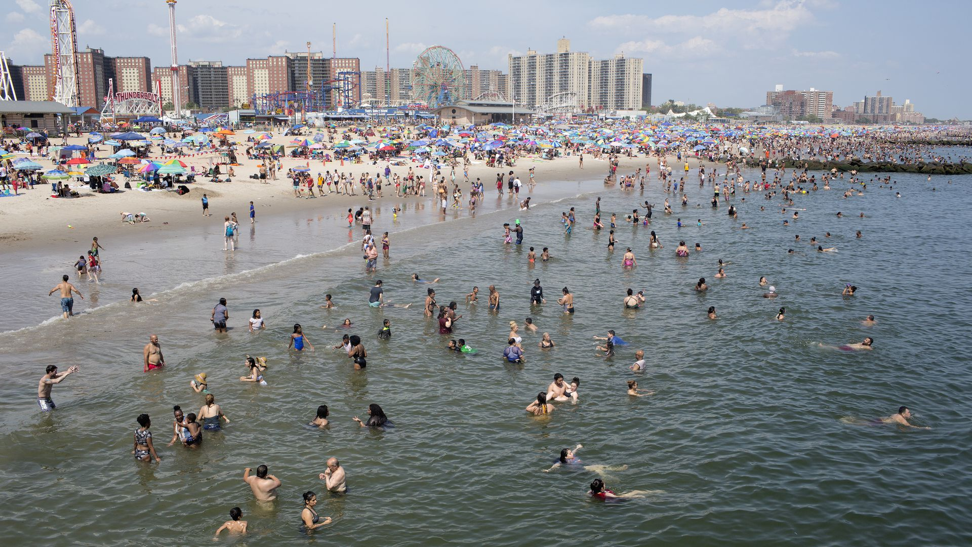 As a heat wave descends upon New York, people seek refuge from the record high temperatures at the beach in Coney Island on July 20, 2019 in New York City.