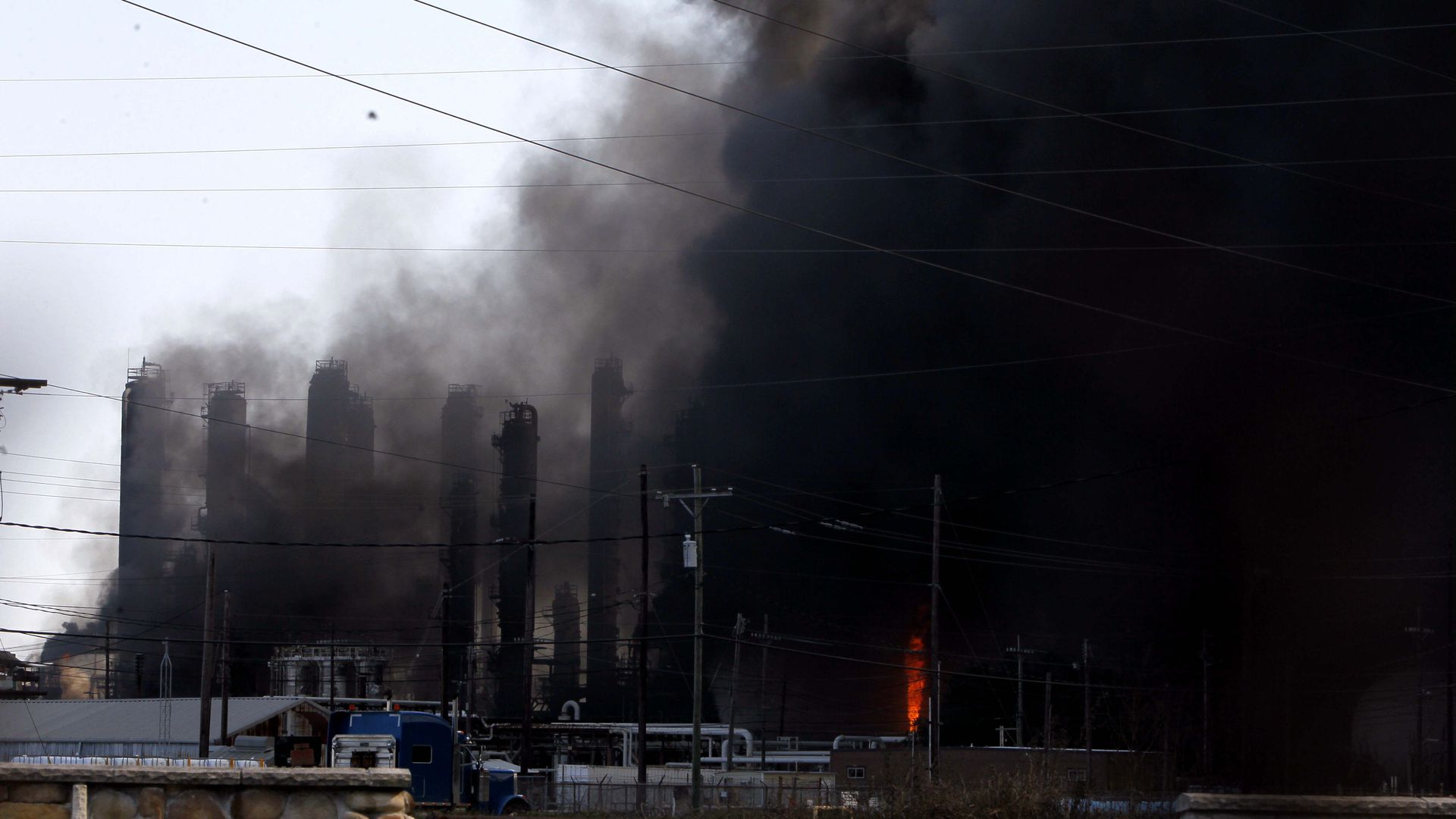 A chemical plant of TPC Group is shrouded by smoke as the fire continues in Port Neches, about 150 km east of downtown Houston, Texas