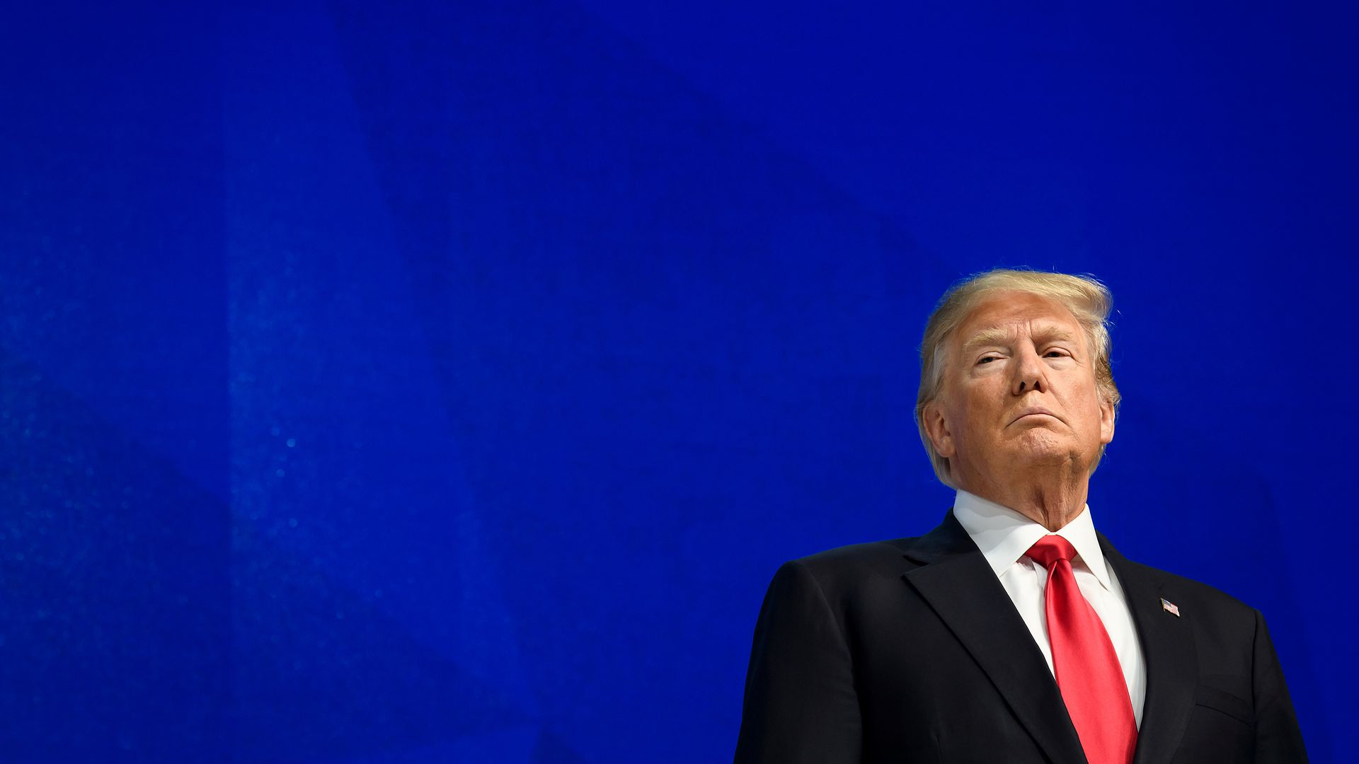 Trump at Davos against a blue background