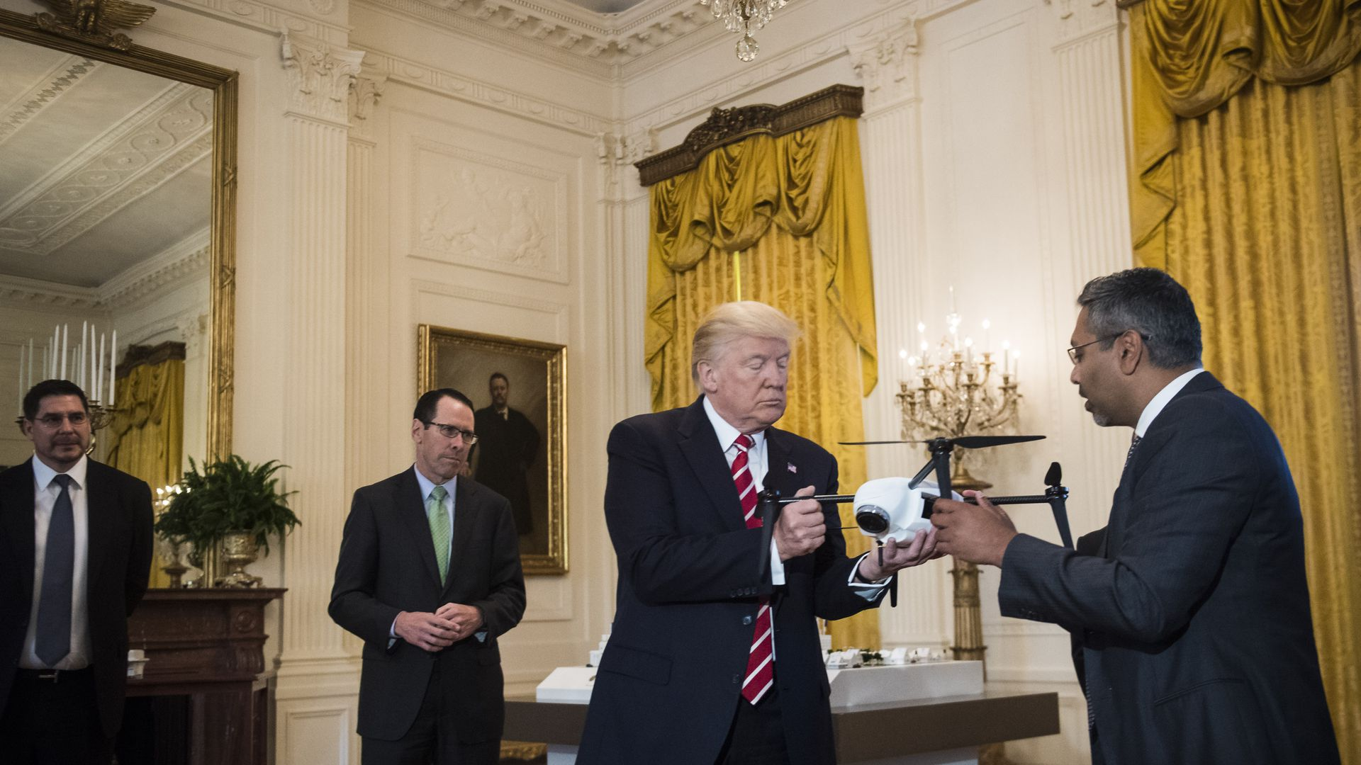 The president examines a drone