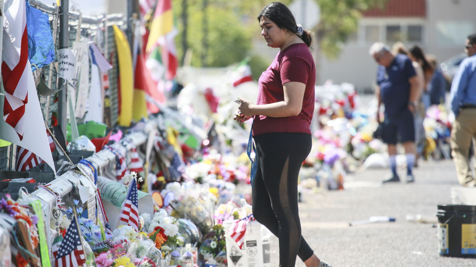 A woman paying her respects at a makeshift memorial for the victims in El Paso. Photo: Sandy Huffaker/Getty Images